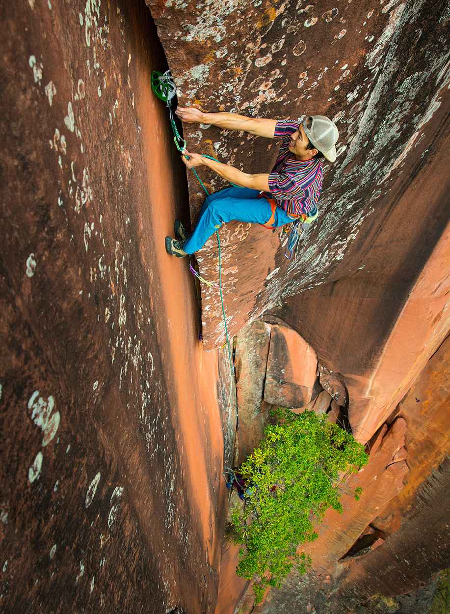 Dropping in some side prow before the final section of the crux.  © Irene Yee/Lady Lockoff Photography