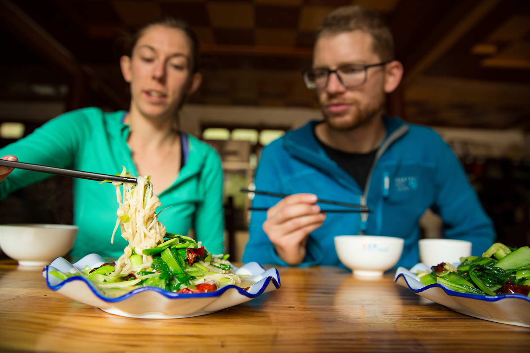 Danny Parker and Ashley Cracroft dig into a local mushroom and chives dish in Liming village  © Irene Yee/Lady Lockoff Photography