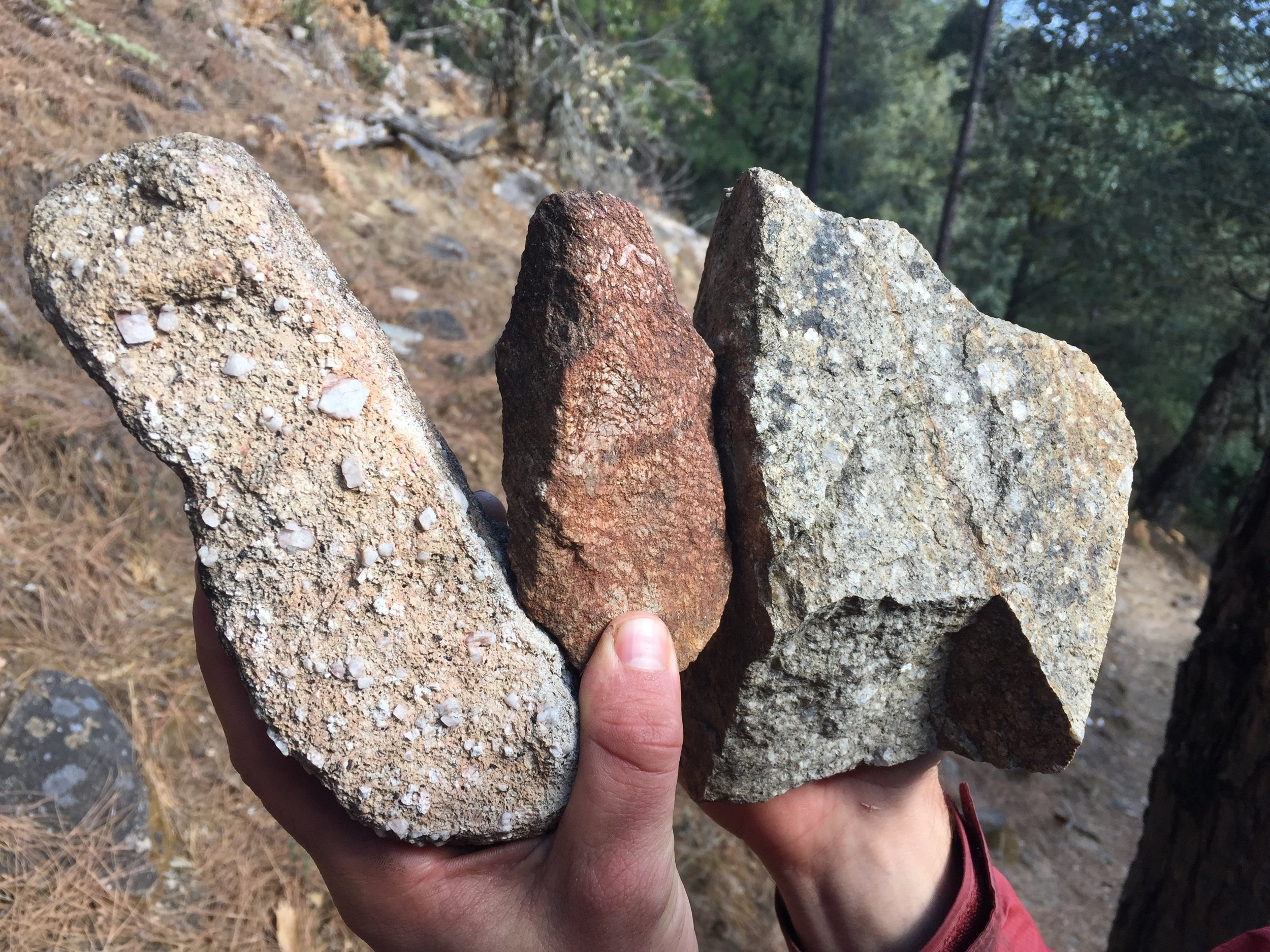 "The variety of rocks found in the boulder field at the base of the wall. After some sleuthing on the Internet, we found a geologic map of Yunnan labeling the area as ""Porphytic Granite Rock."""