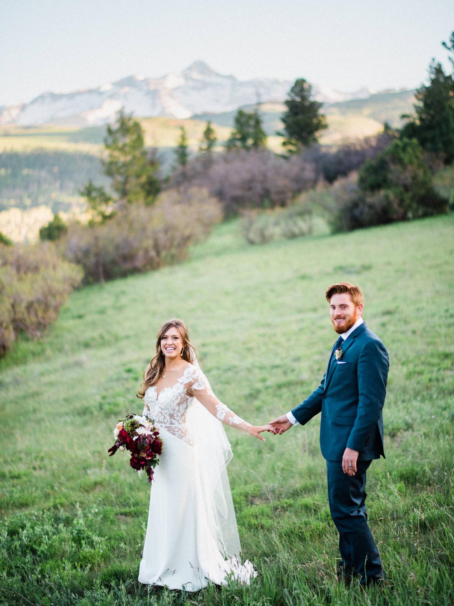 Outdoor Telluride Wedding Bride and Groom in grassy field