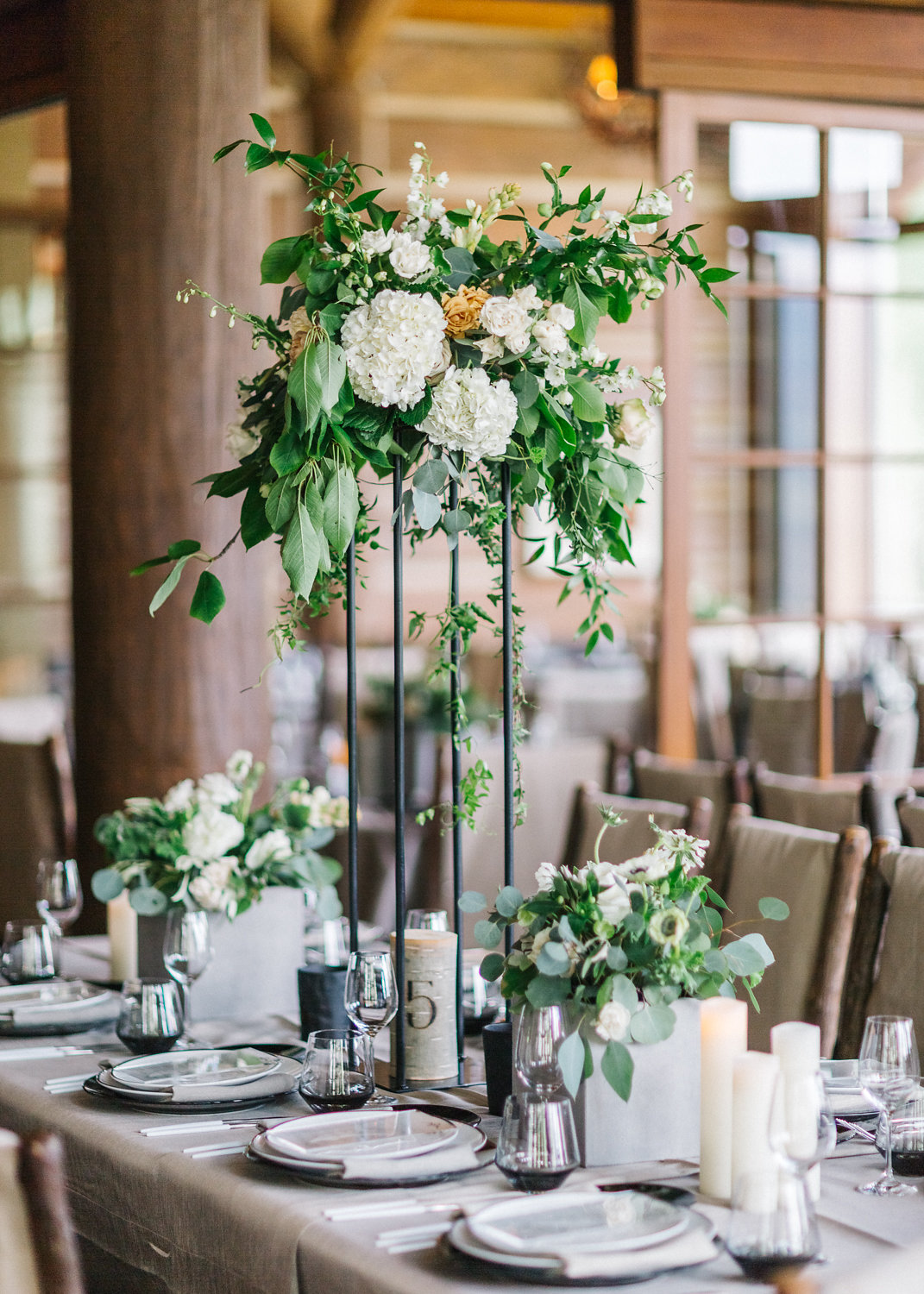Modern and lush table centerpieces at Zac's Cabin, Beaver Creek CO