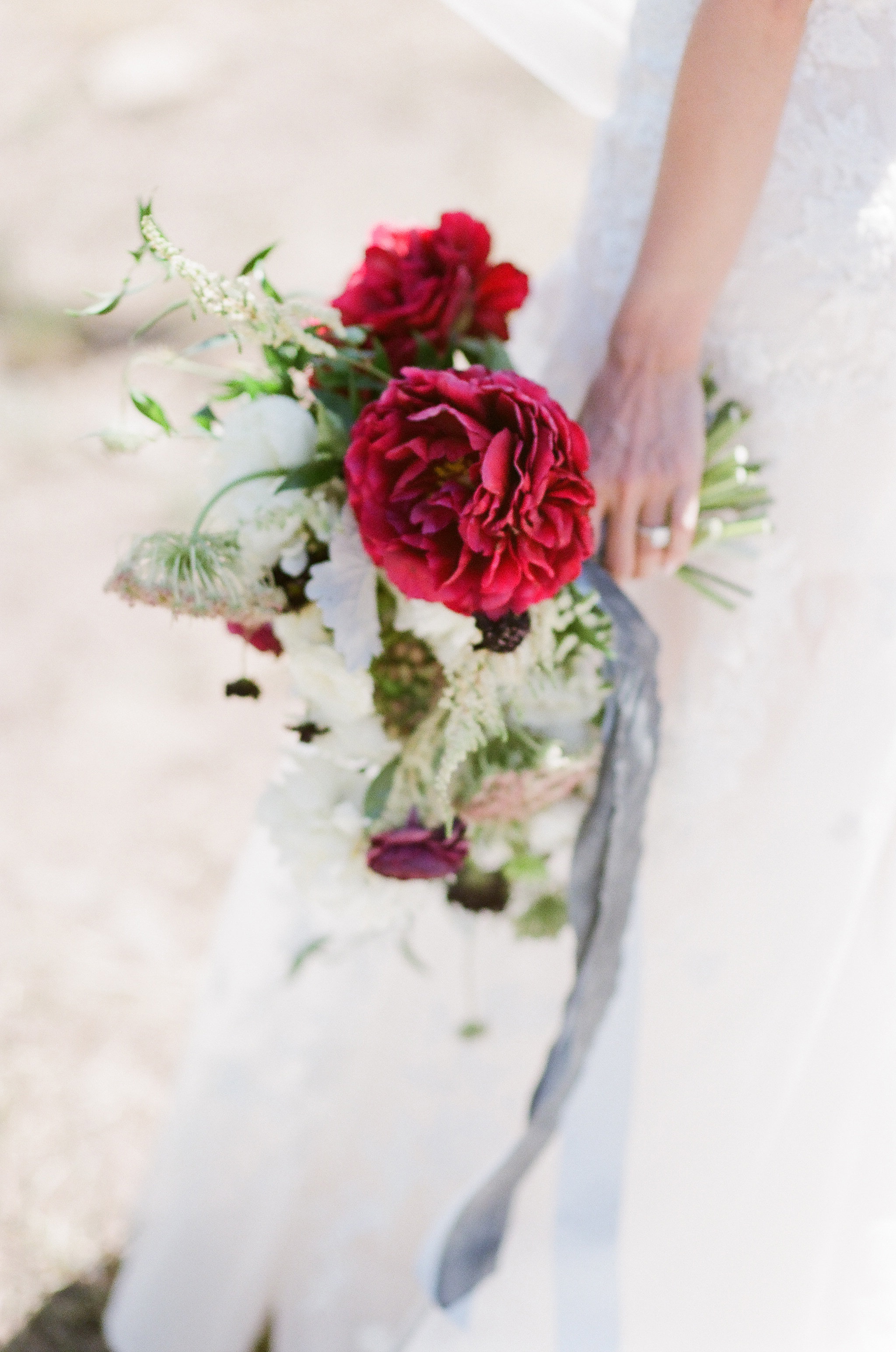 wedding bouquet with red peonies