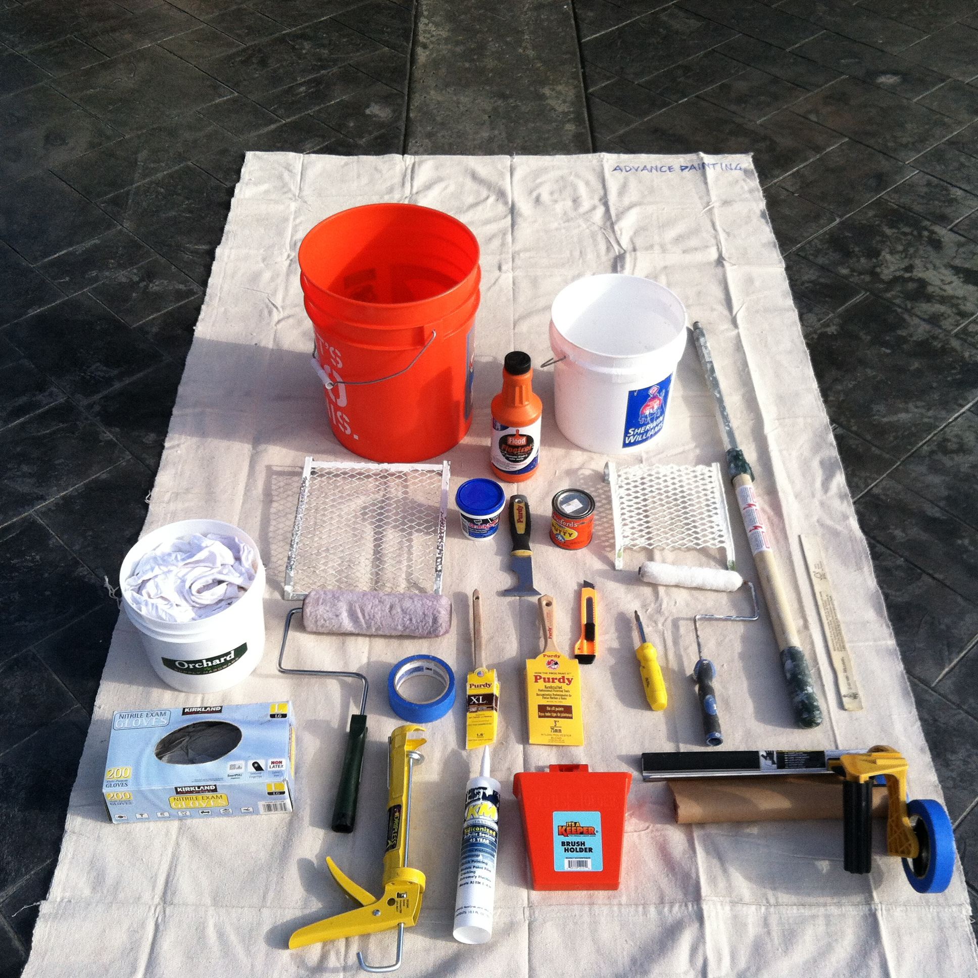 Laying out your tools (in one location) is an important aspect of starting your paint project correctly.