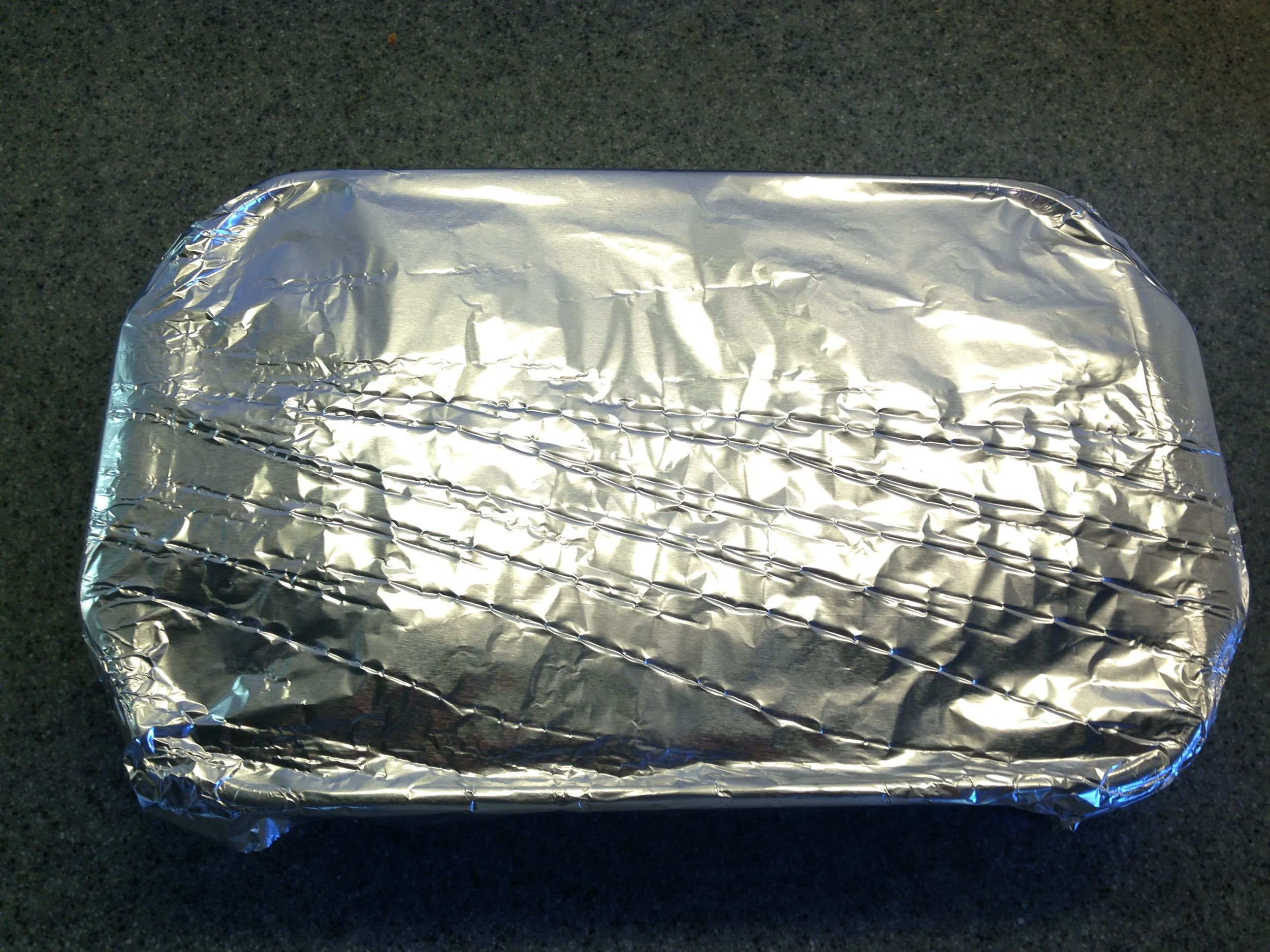 Wrap tightly with foil. The point here is to steam the meat.