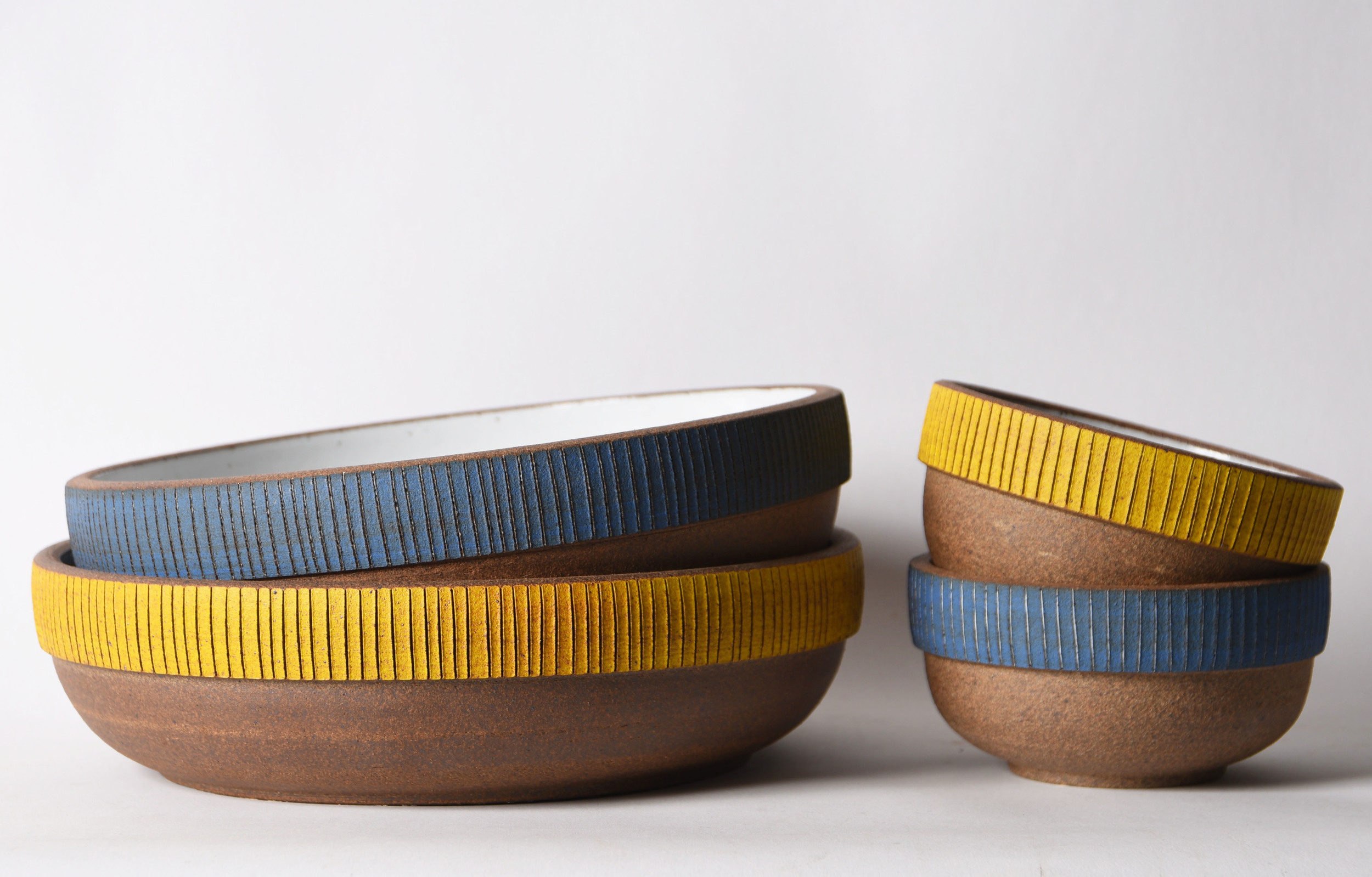 yellow and blue etched blue bowls group.jpg