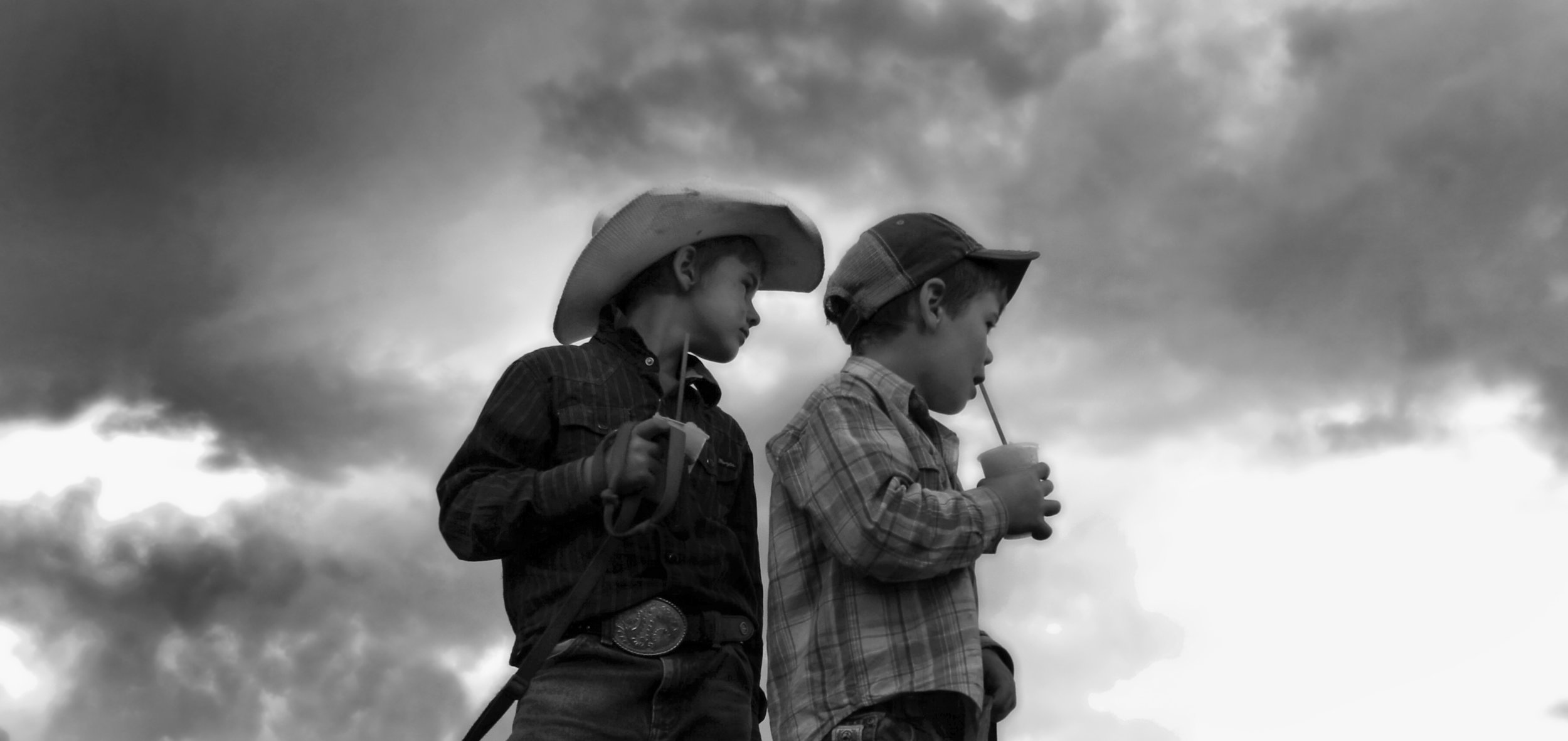COUNTRY KIDS - Corryong - AUSTRALIA   These country kids, (farmer's sons) photographed at a rodeo in Corryong Victoria, are another breed from city kids. They ride horses, buckjump on young steers, round up sheep, and drink slurpies.