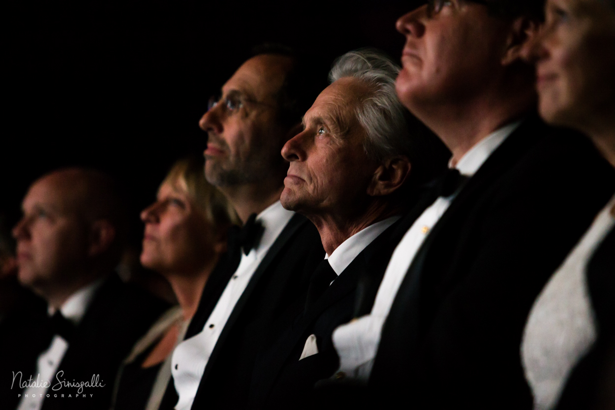 Michael Douglas watching highlight reel of his prolific career in Eastman's historic Dryden Theater