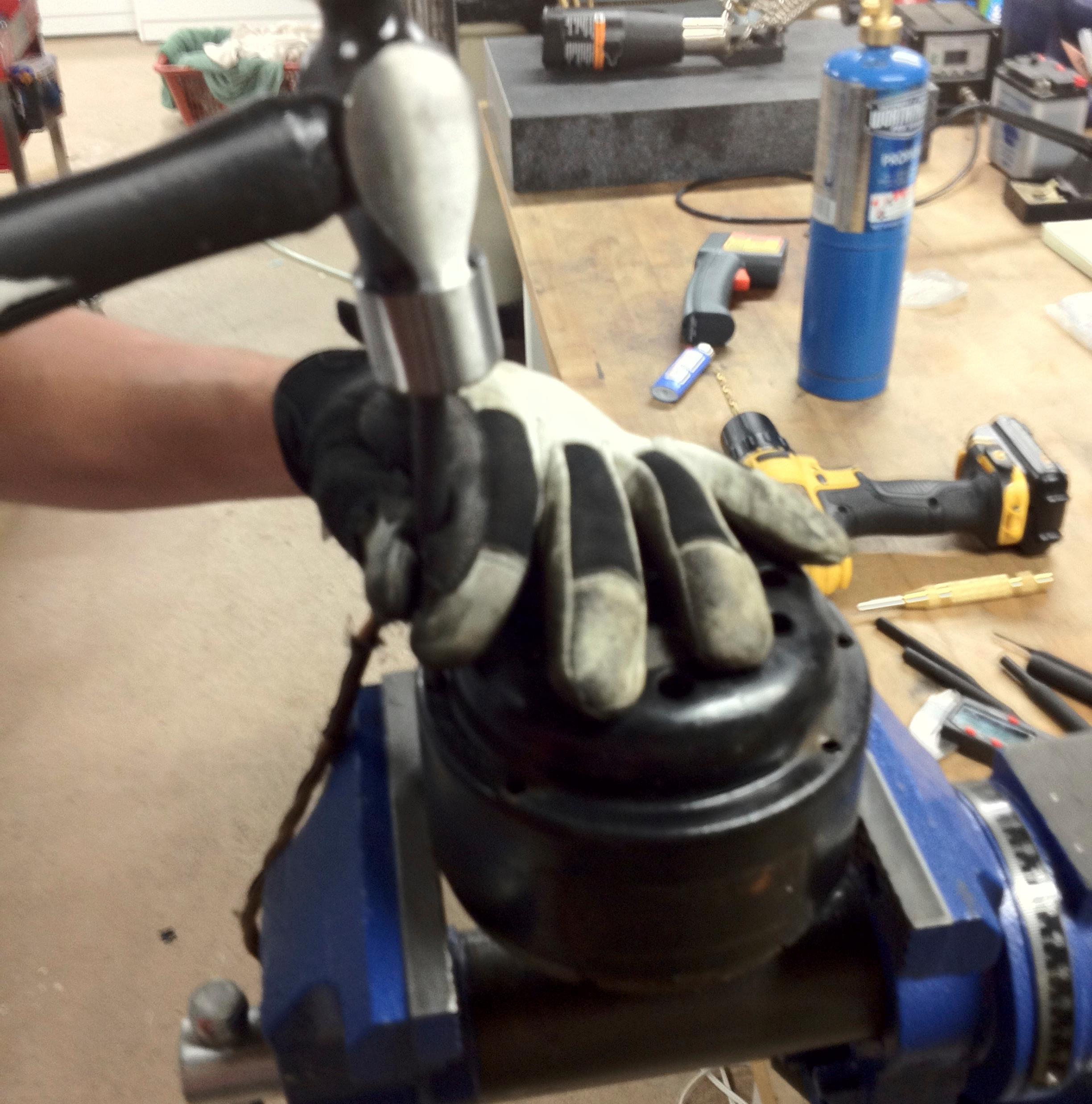 Using a punch and hammer gently punch the motor out from the holes that you drilled.