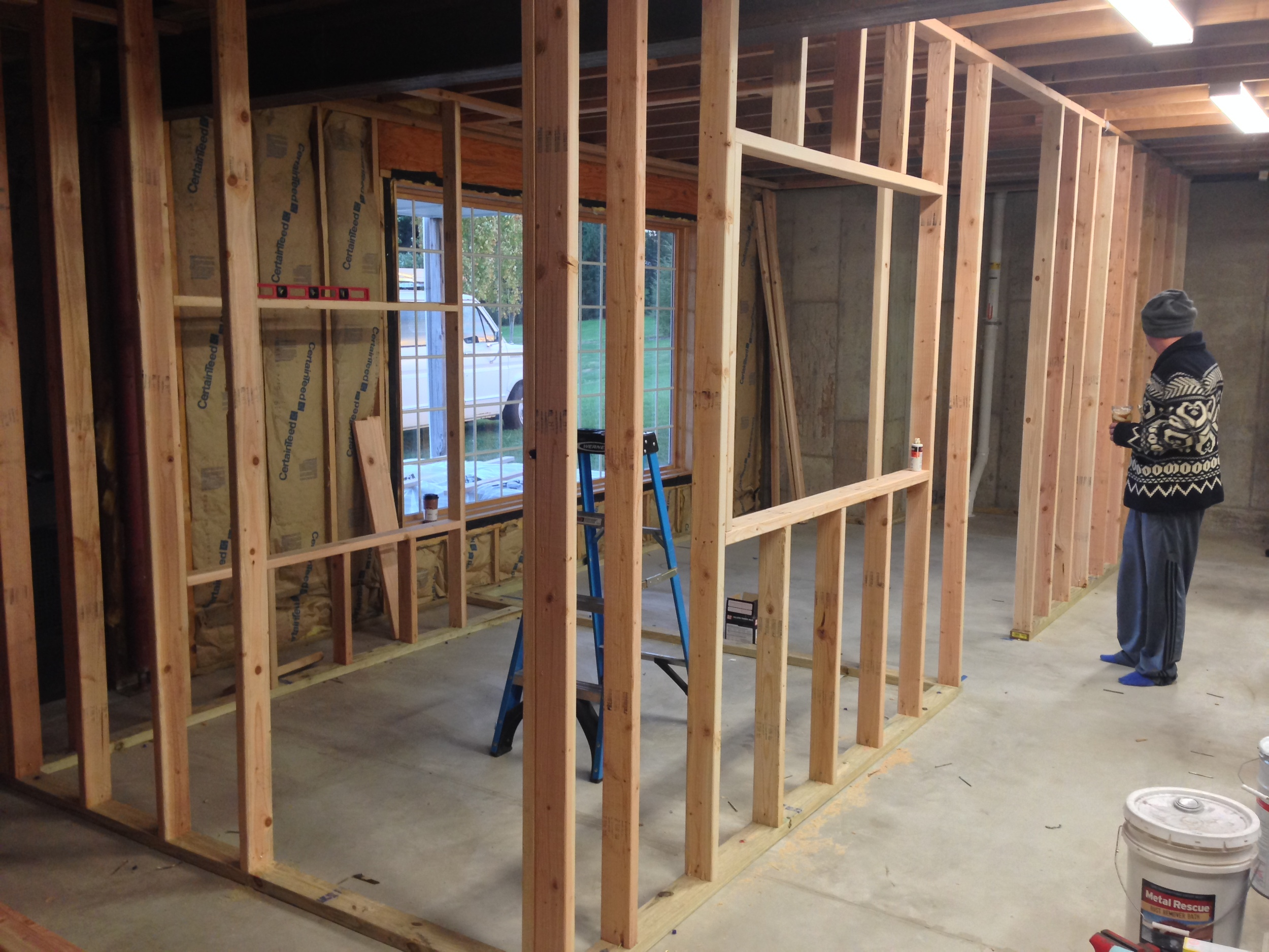 """Framing up the """"paint room"""" and """"dust room."""" These will get drywall on the insides as well as cheap laminate flooring from the local surplus center."""