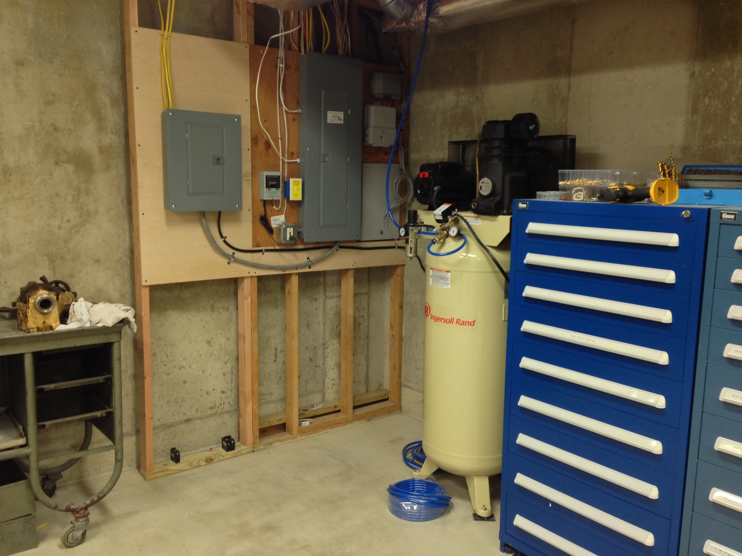 New 125amp sub panel went in to power the shop. Vidmar cabinets next to the Ingersoll Rand 5hp compressor.