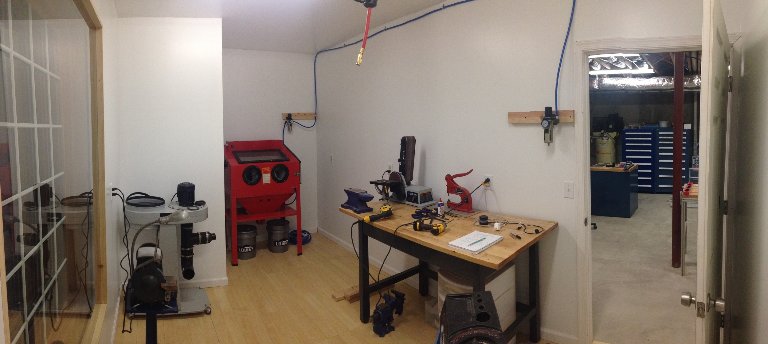 """A panoramic shot of the """"dust room"""" showing the sand blast cabinet and dust collection system. The buffing system will be installed here as well."""