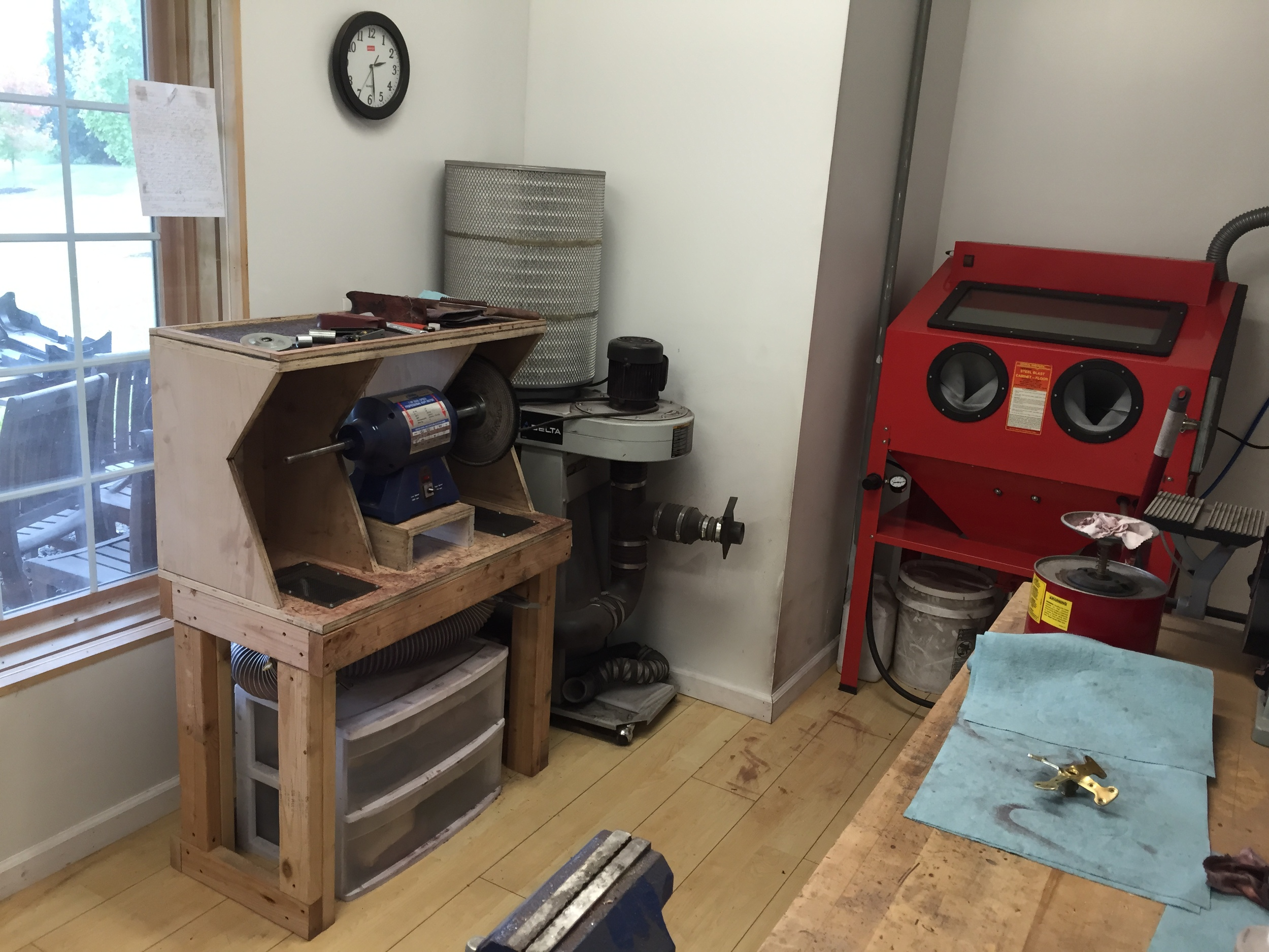 """a shot showing the blast cabinet and buffing cabinet within my """"dust room."""""""