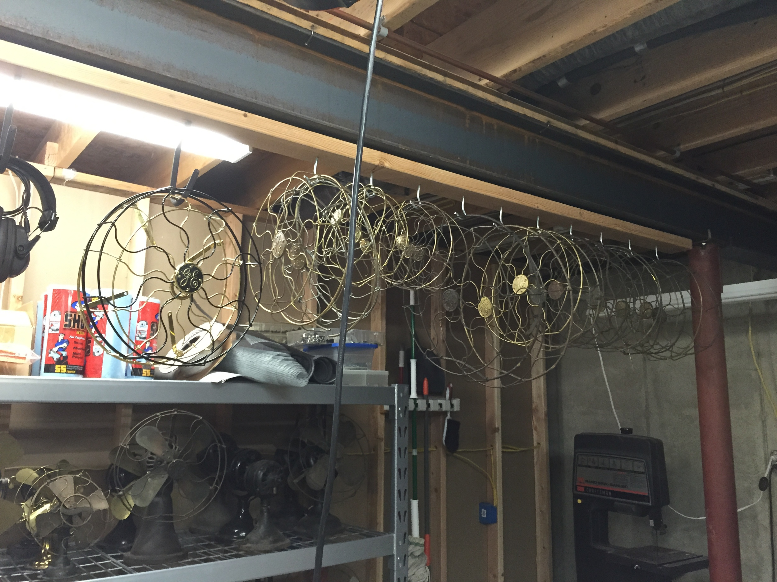 """Using magnets, I attached a 2x4"""" to the steel beam along my shop's ceiling. I then hang cages from hooks."""
