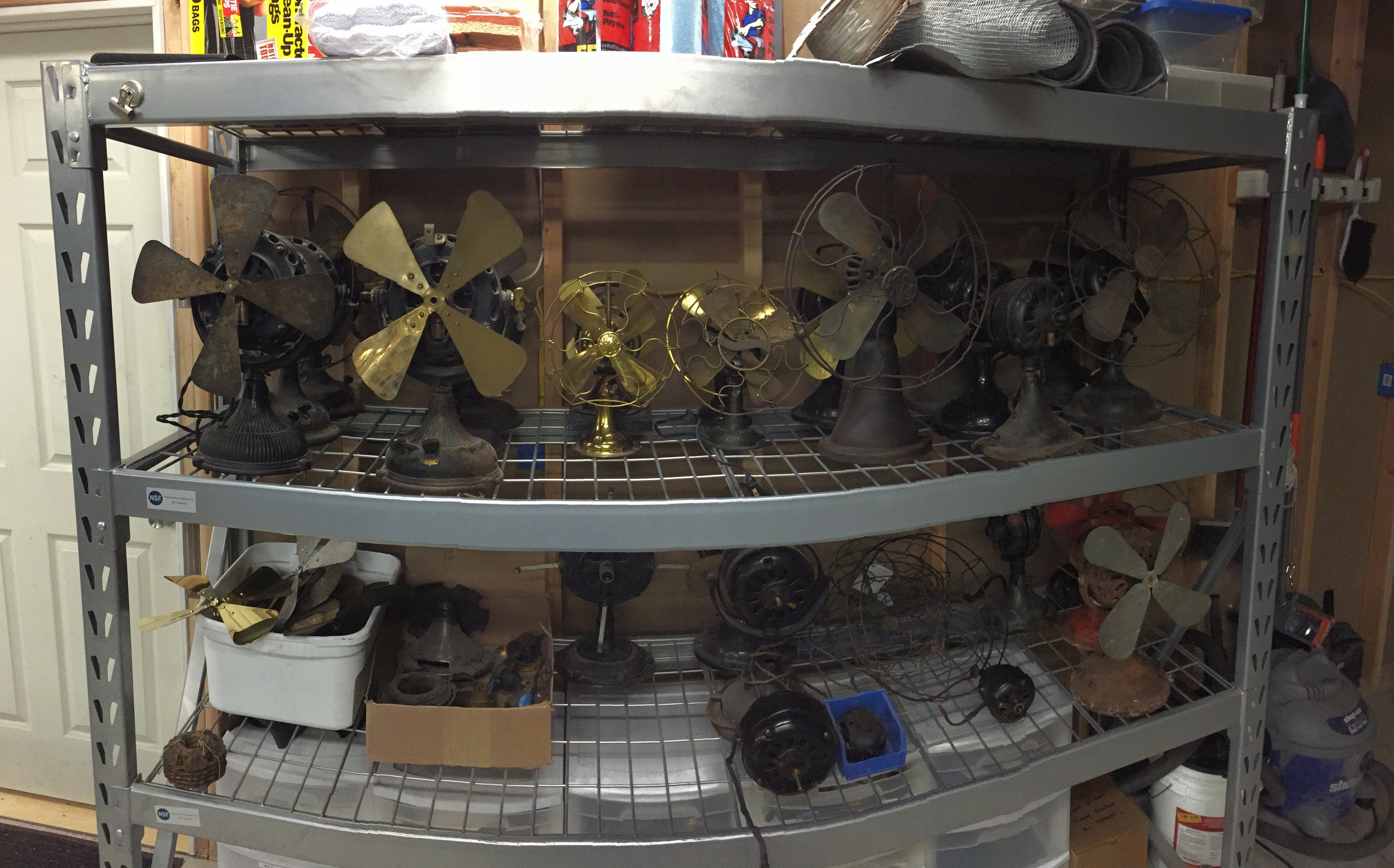 """My fan """"queue."""" These are all my personal fans waiting their turn for restoration. I've been slowly working my way through by avoiding buying new ones!"""