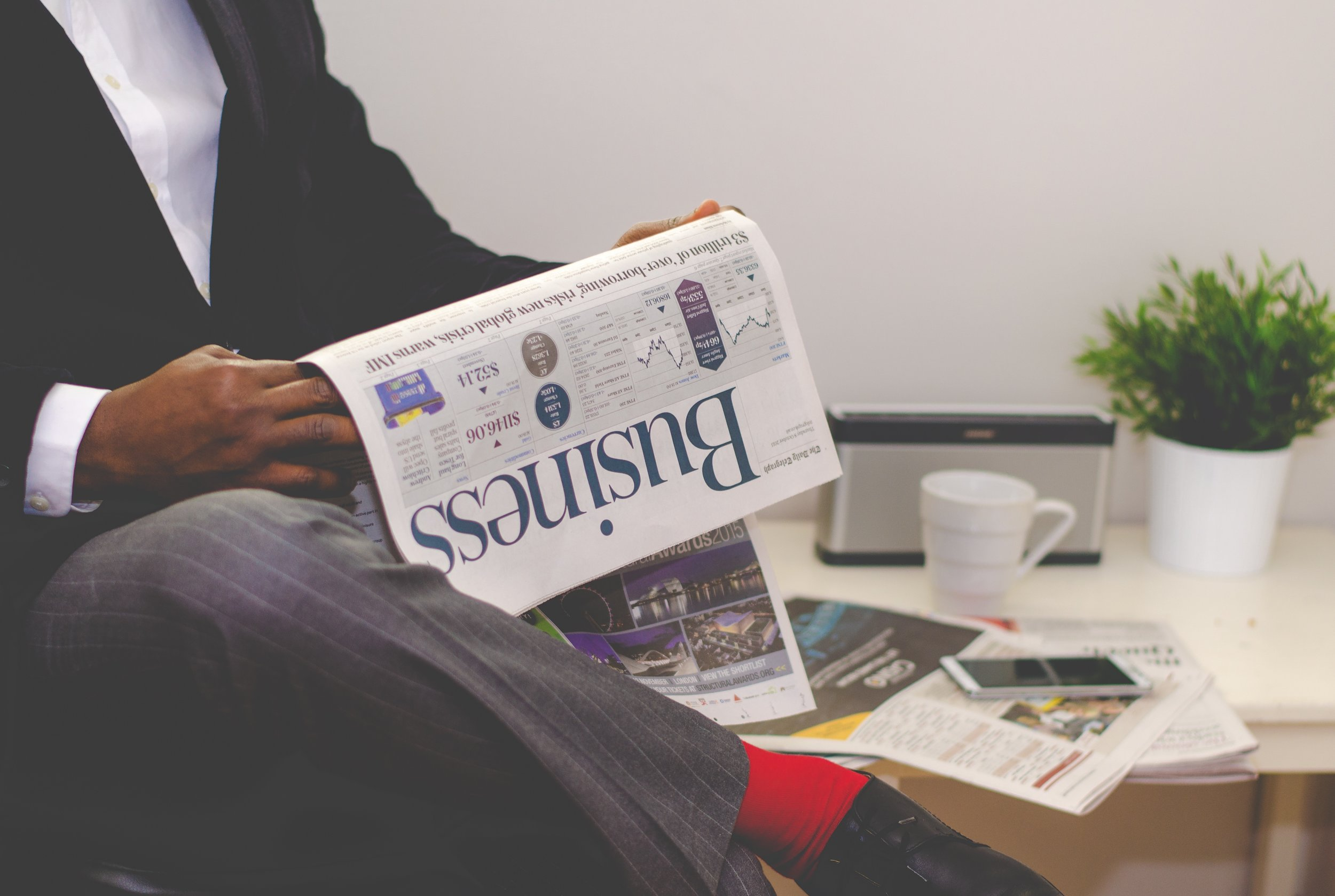 Guy reading business newspaper.jpg