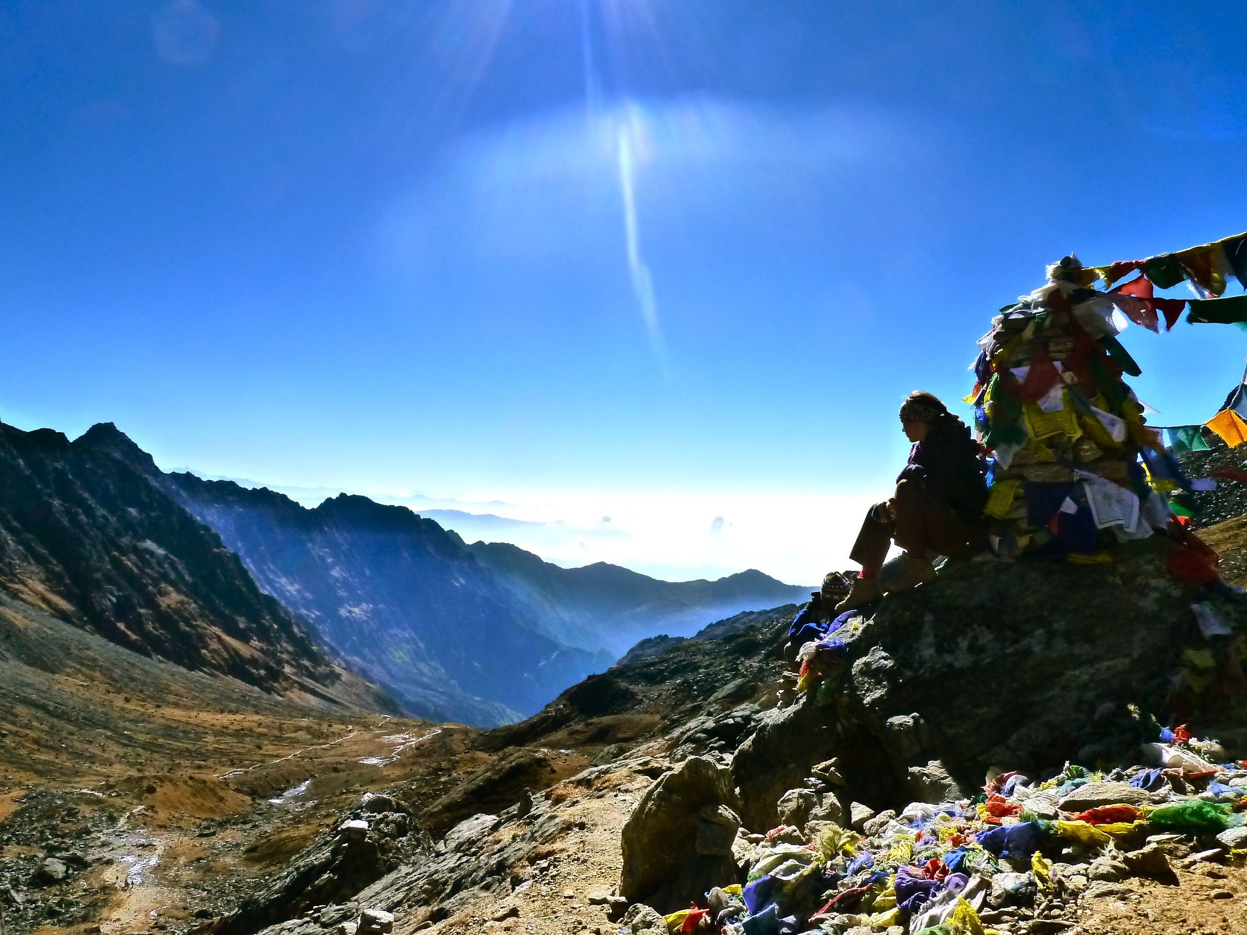 A moment of contemplation. After three days of walking up, we begin our descent of the Gosaikunda pass