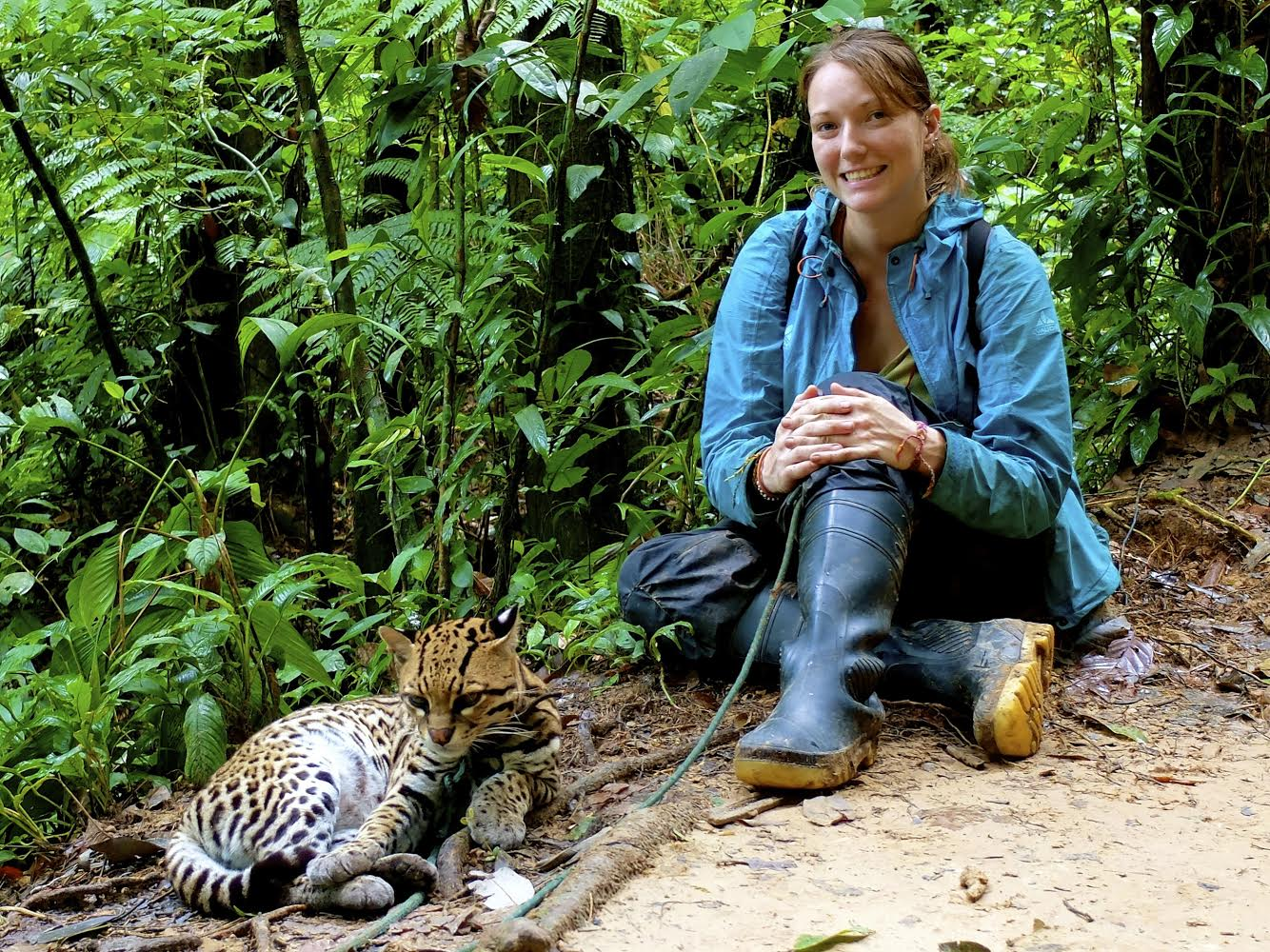 Chelsea relaxing with Tigre the Ocelot