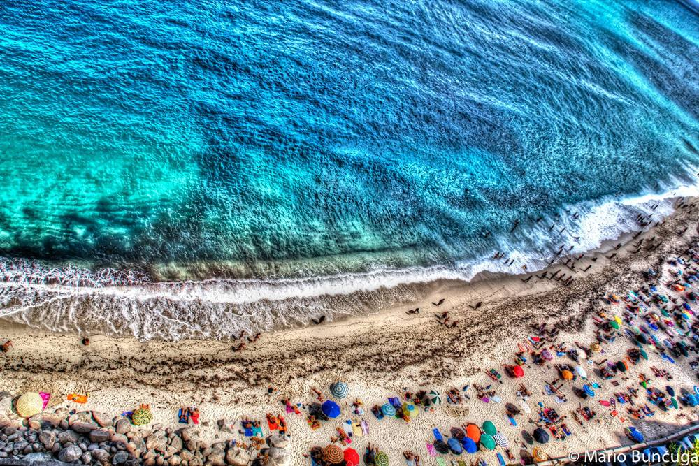 An aerial view of a beach in Tropea, Italy by Mario Buncuga