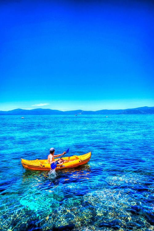 Going for a paddle in Lake Tahoe, CA by Drew Redmond