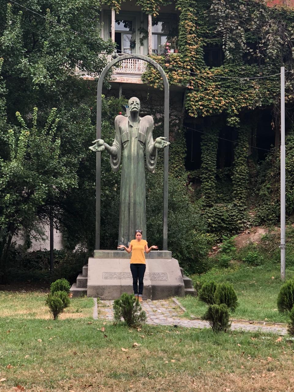 A shrugging statue