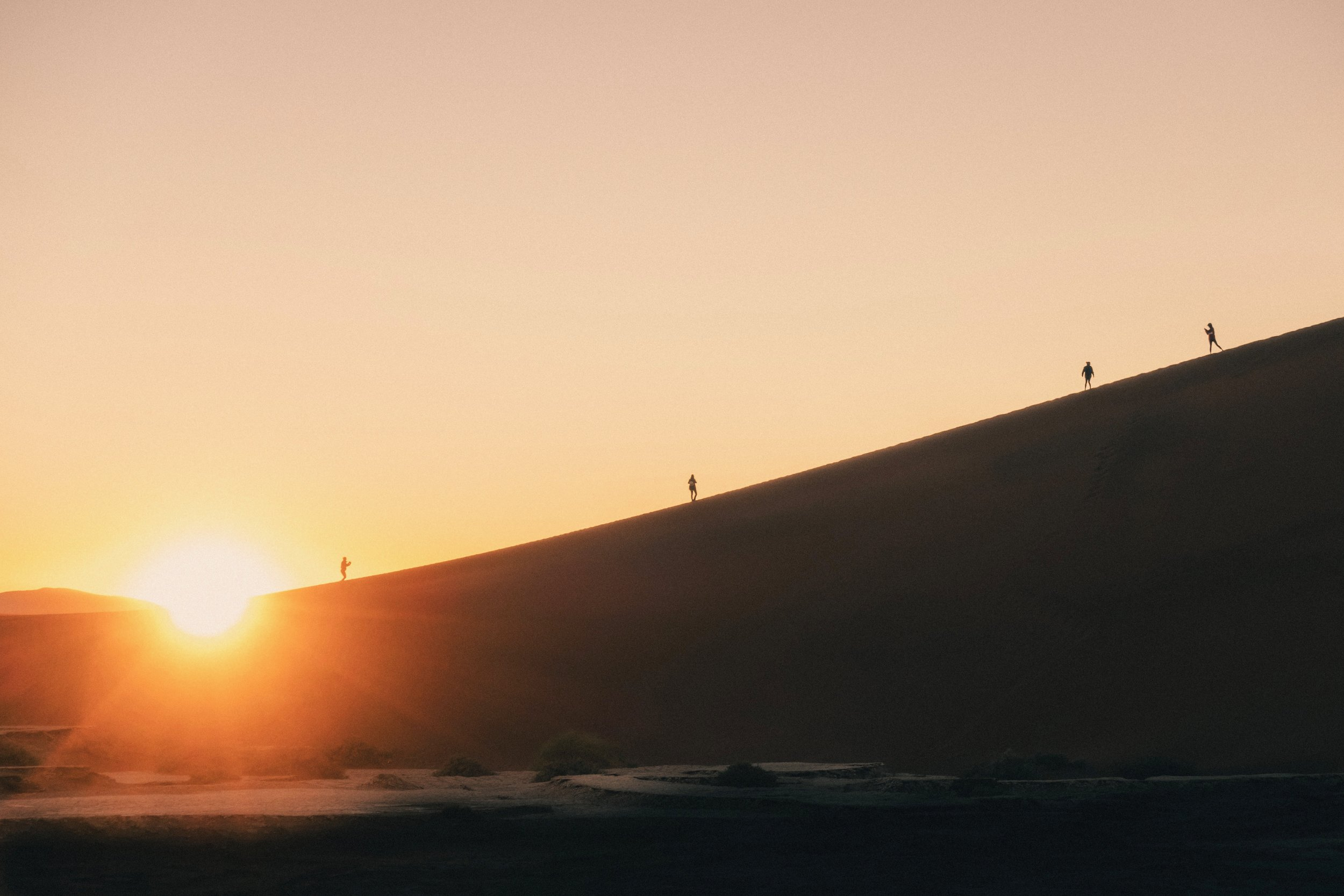 """Hikers try to beat the sunrise on """"Big Daddy Dune"""""""