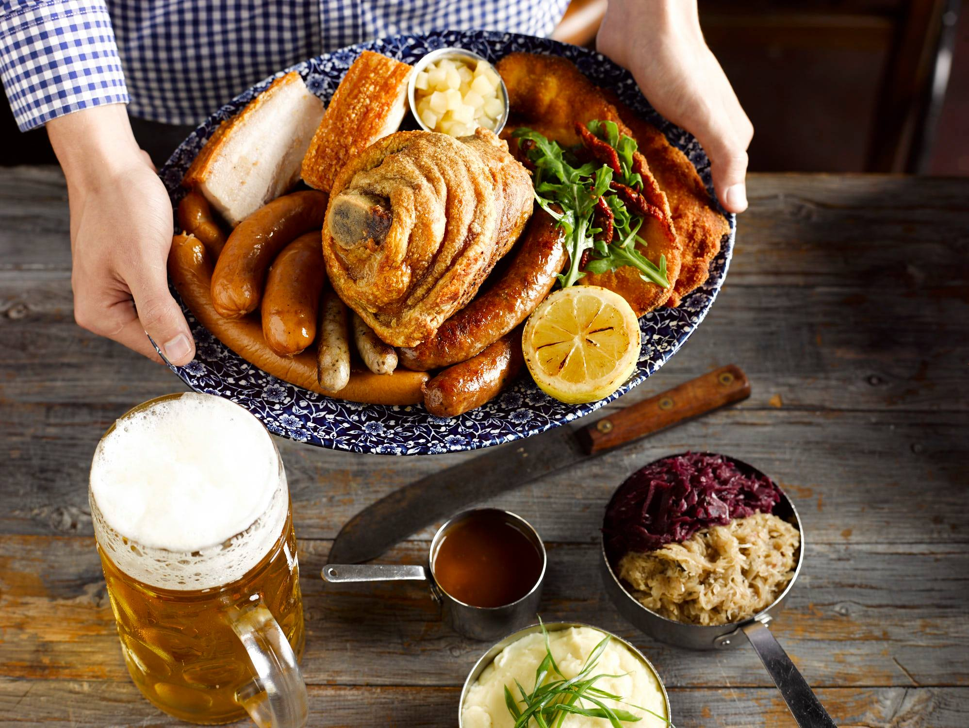 OKTOBERFEST FEASTING MENUS - From crispy pork knuckles to warm salty pretzels and platters of unpronounceable Bavarian meats, you and the crew can tuck into the most delicious authentic feasts for the full six weeks of Oktoberfest/SEE OUR FEASTING MENUS