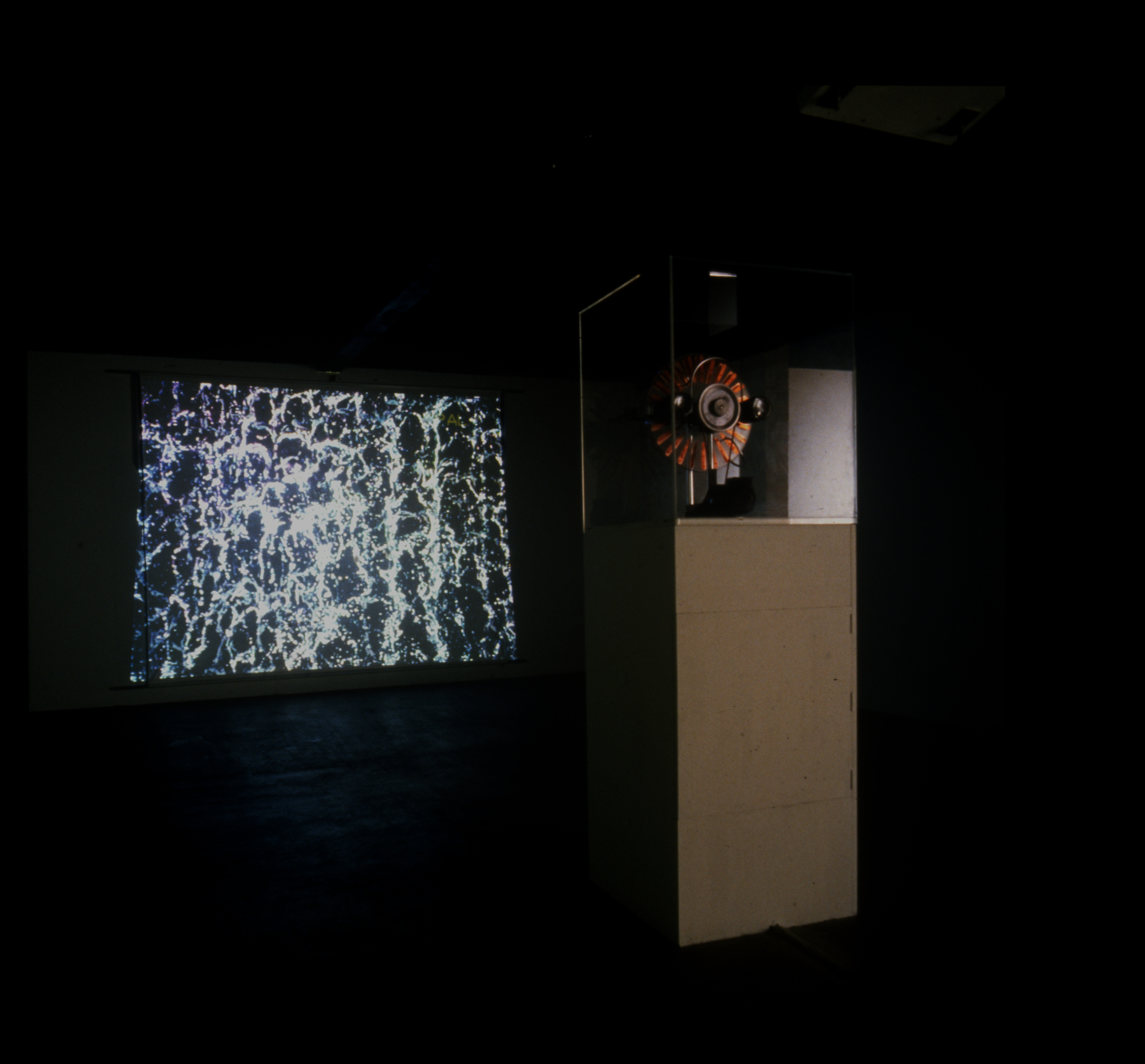 "Reservoir 1991, installation, projection, Wimshurst machine, cctv camera, three 3"" TVs, strobe, water dropper. First shown John Hansard then CCB, Lisbon Portugal, Tate Liverpool, Newlyn Art Gallery"