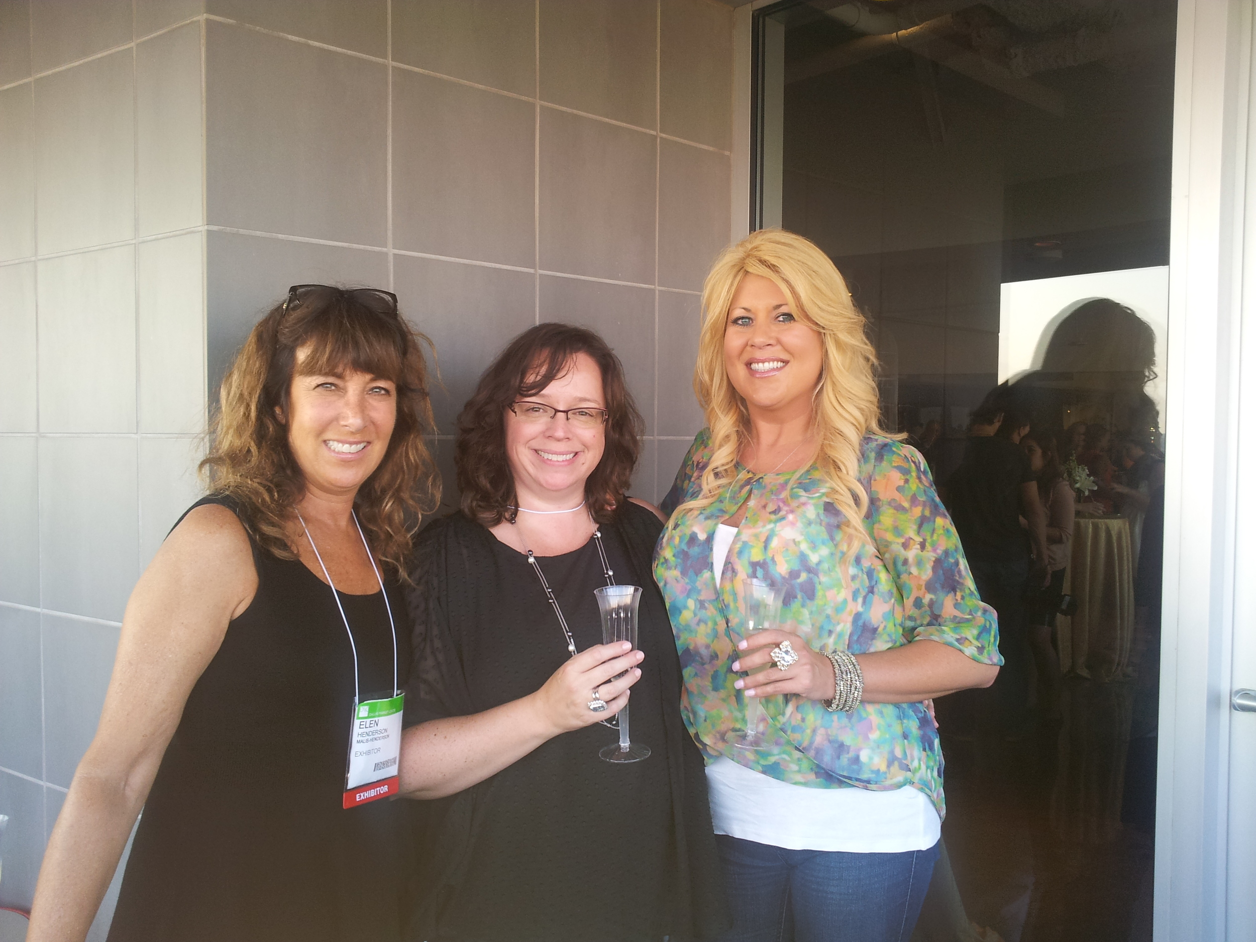 Elen and Nicole from Malis-Henderson with Rebecca from Azarue's Bridal and Formal in Bossier City, Louisiana  http://www.azarues.com/    This is a morning pic from the Dallas Bridal Market, so those must be mimosa cocktails !