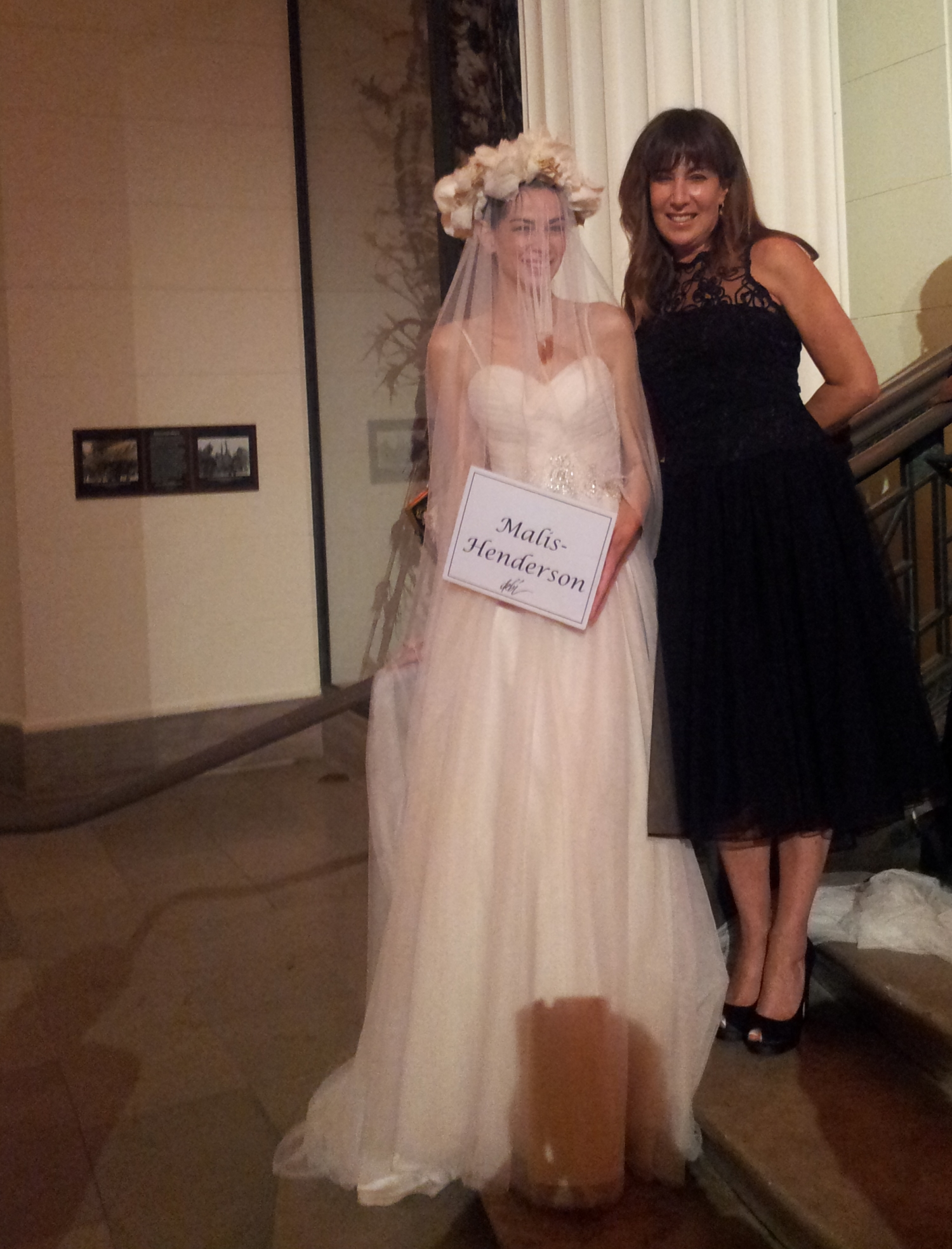 Each year at the DEBIs, guests are greeted by models that line the two huge curved stairways leading to the second floor, showing designs from the DEBI Nominees.  Here, the model is wearing Elen's fabulous design of a Runway Floral Headpiece and veil, with Elen proudly by her side.