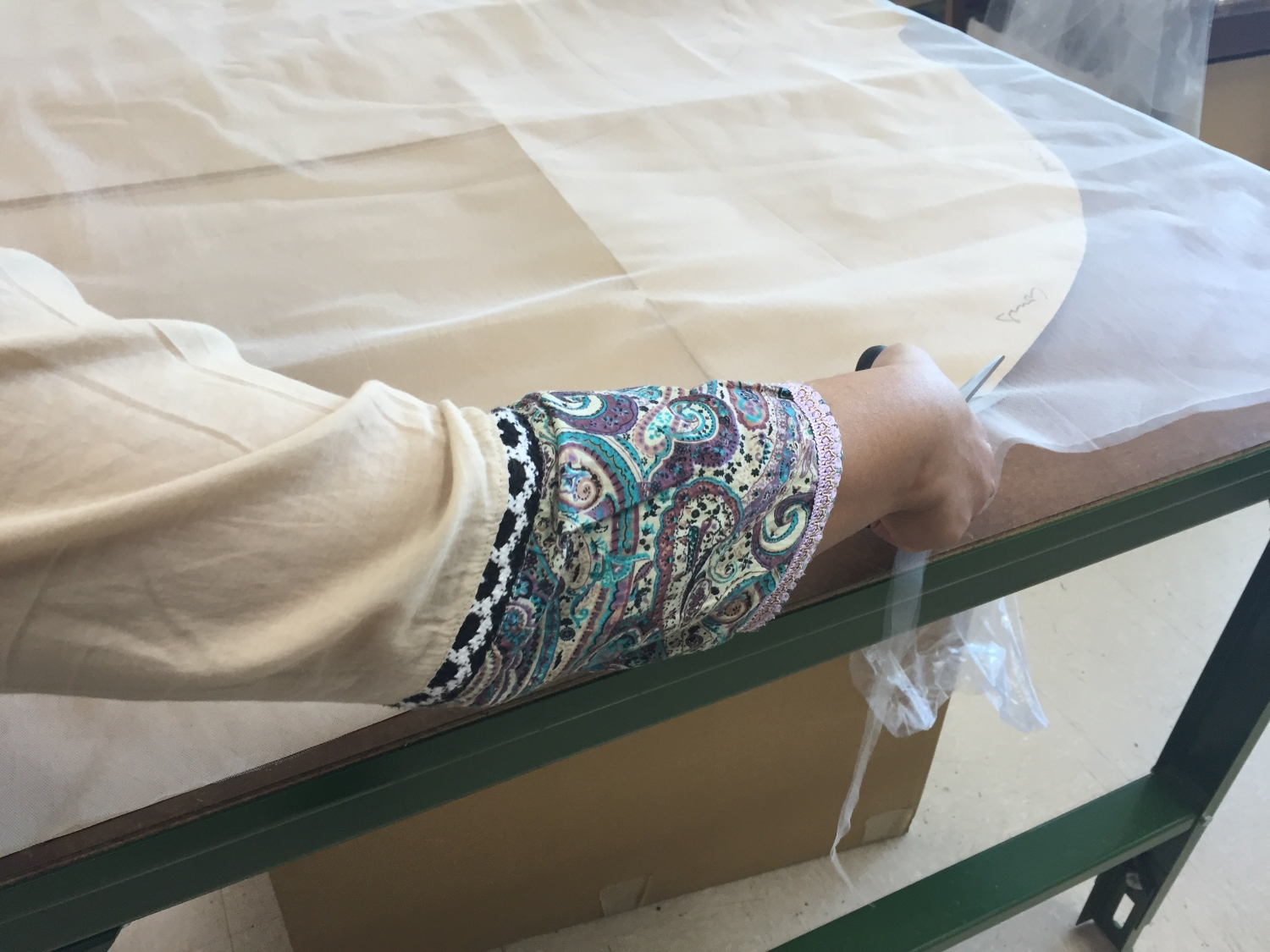 CUTTING  - The first step in shaping the material requires a steady hand to create the base upon which everything else will be added to create a beautiful veil