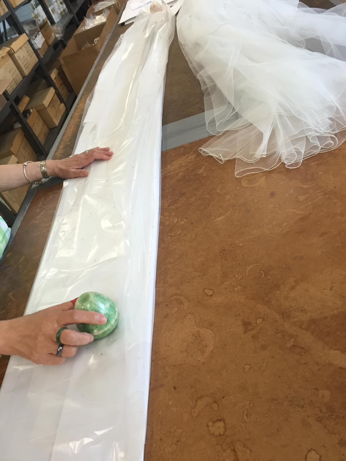 FOLDING  - There is an art to ensuring that all our hard work arrives at the bridal store in proper condition to be carefully unfolded, given a light steam, and present its magnificence to each bride.