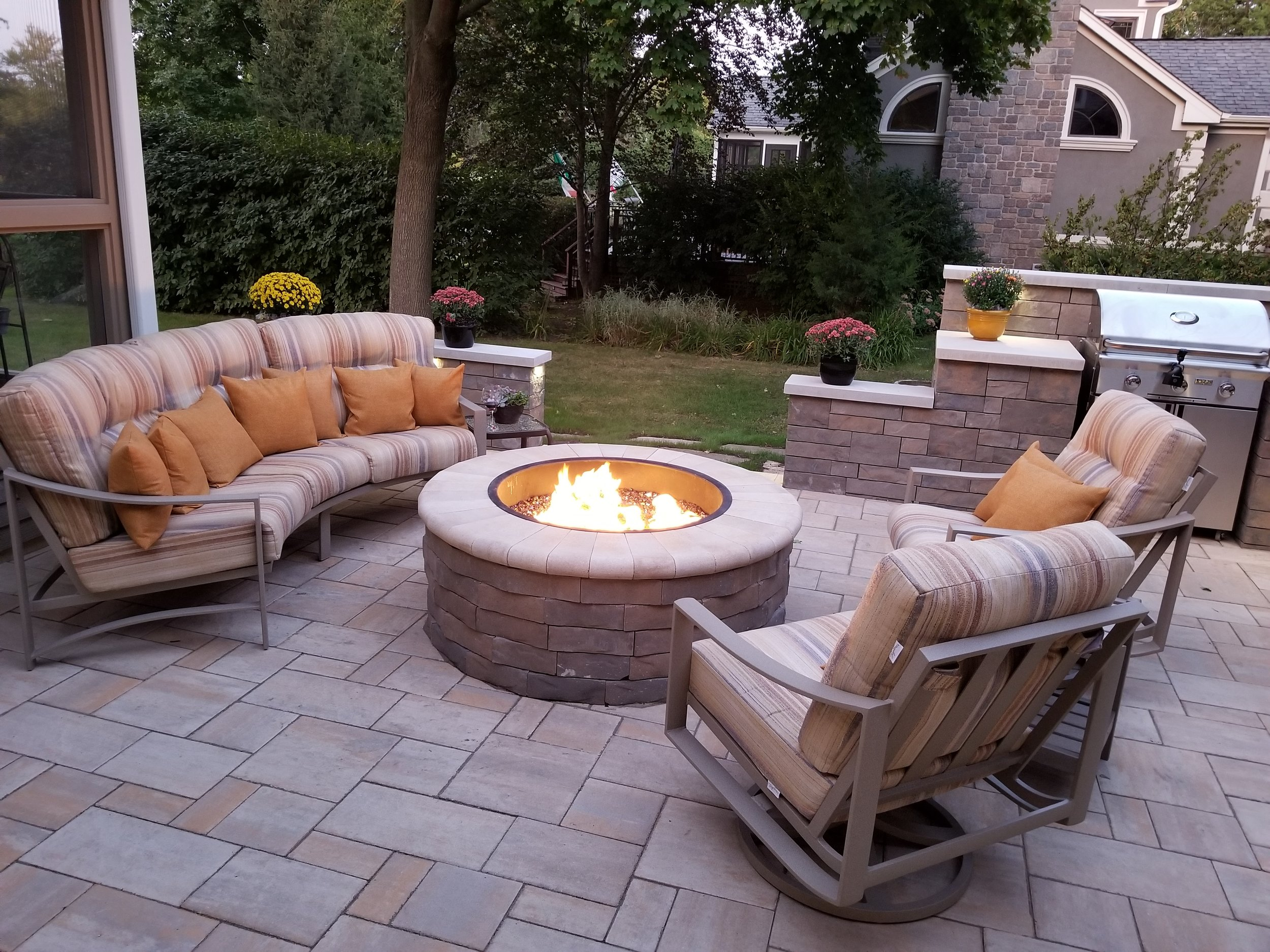 We created this lovely County paver patio with fire pit and an enclosed barbecue with Techobloc walls.