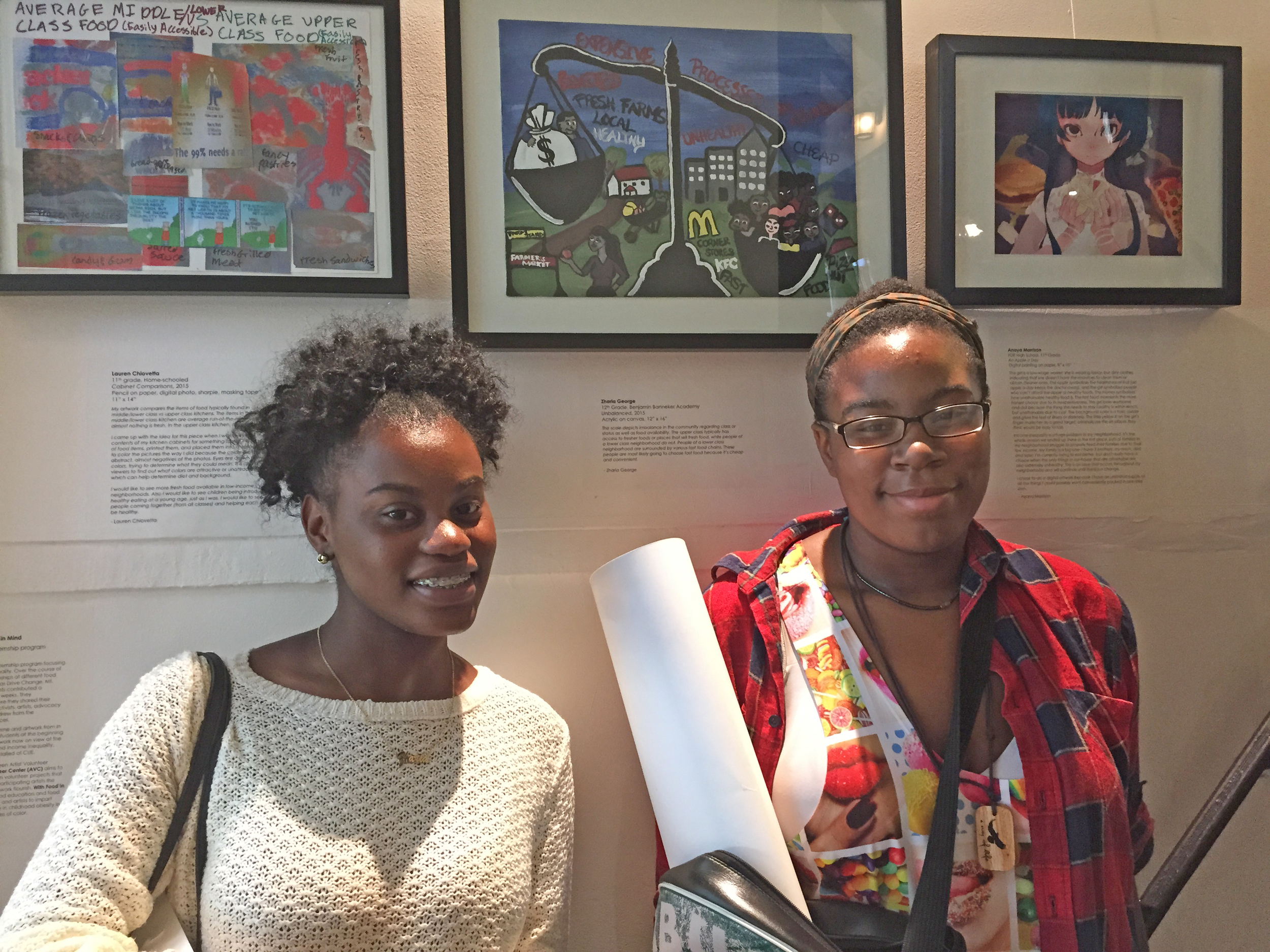 Zharia and Anaya in front of their artwork at the Sensing (In)Equality exhibition at Old Stone House in Brooklyn.