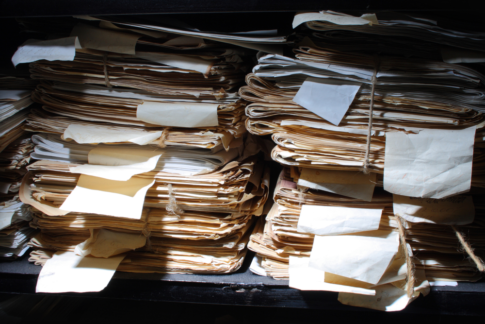 The stack of paper loomed ominously out of the dark... (Source: Shutterstock)
