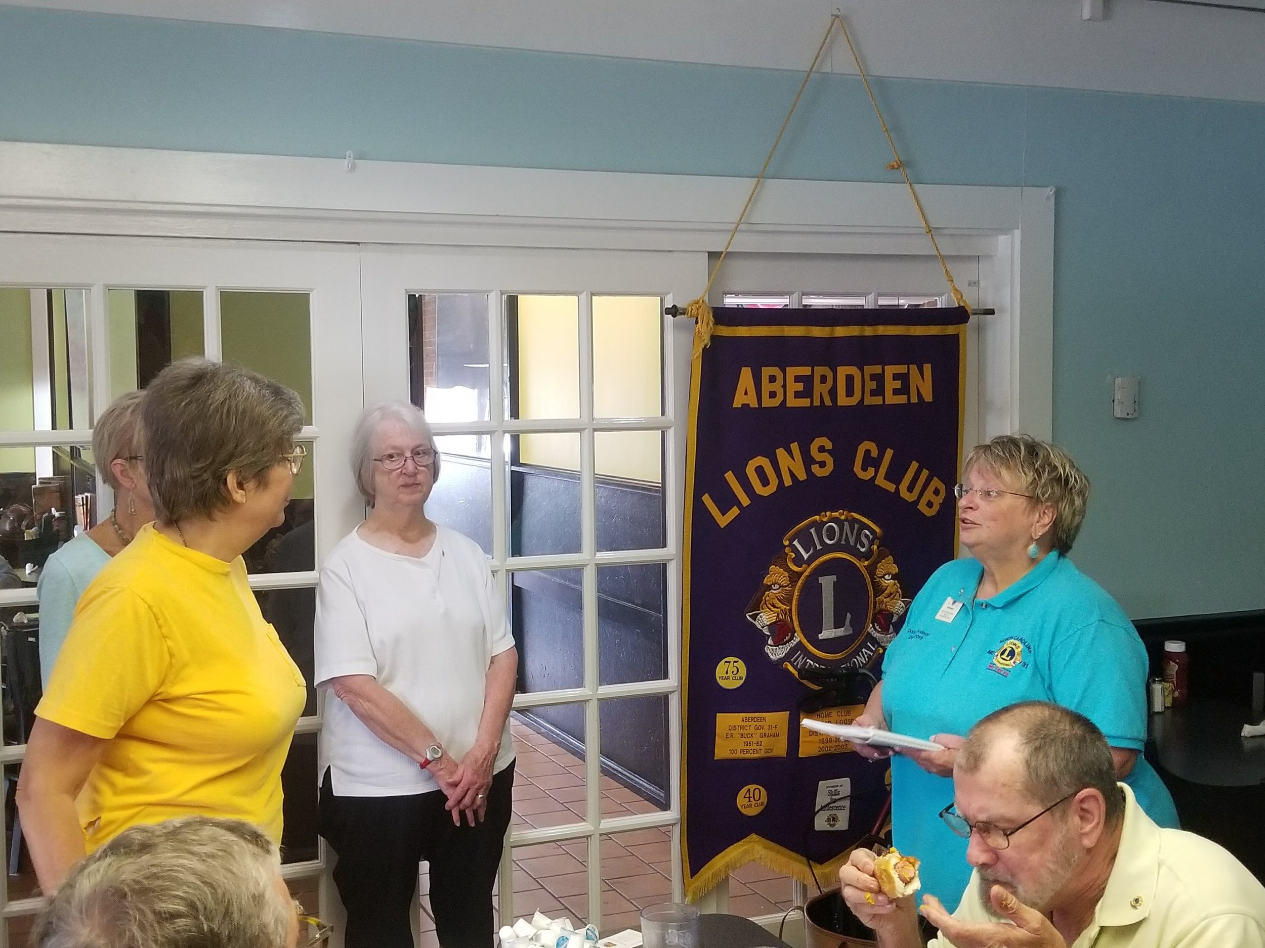 New Lion Deborah Kilcollin, her sponsor Kay Mack, new Aberdeen Lion Jeannette Roberts,nd 1st Vice District Governor Susie Dailey inducting our new members