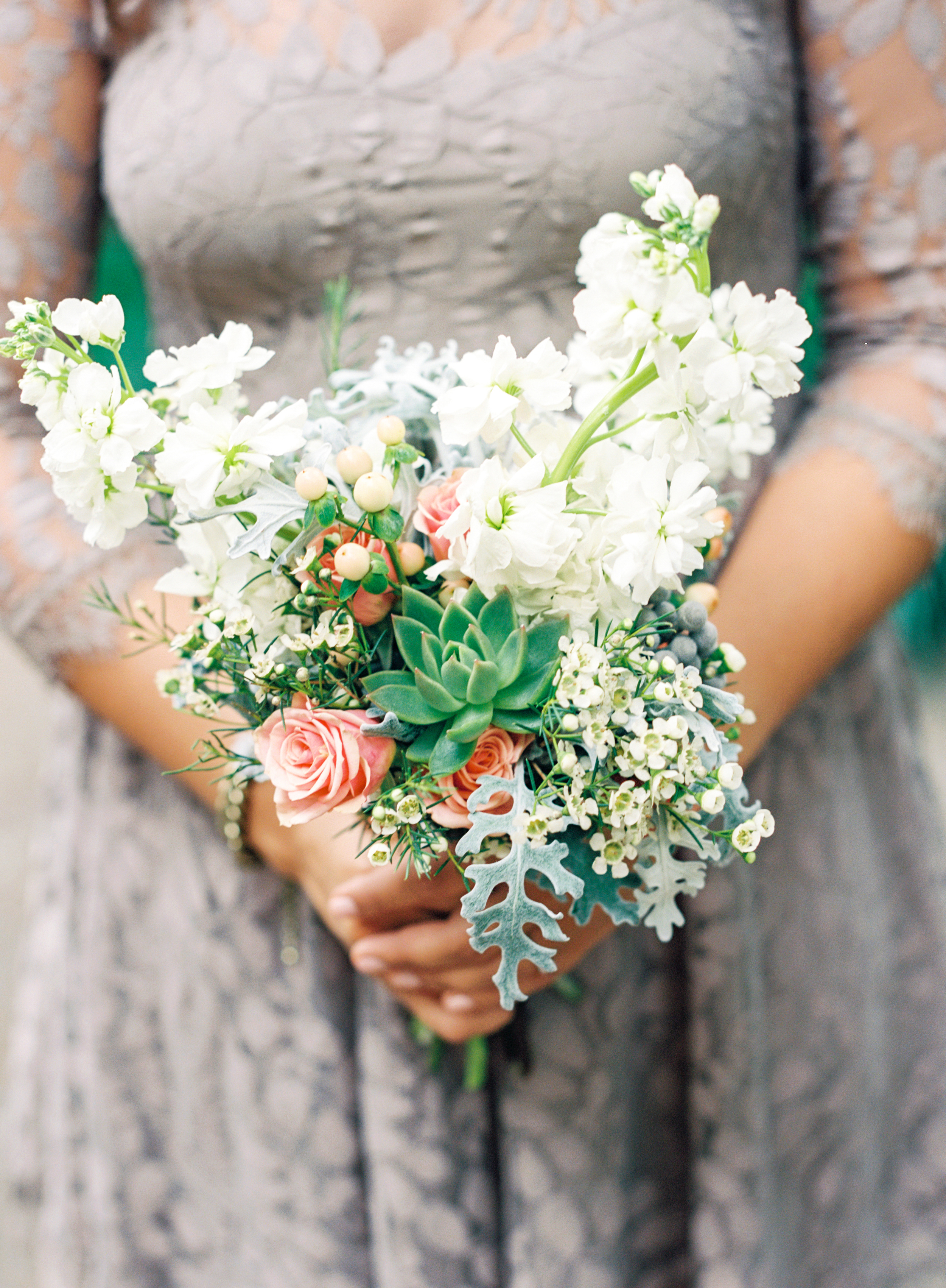 Romantic peach and white bouquet with succulent