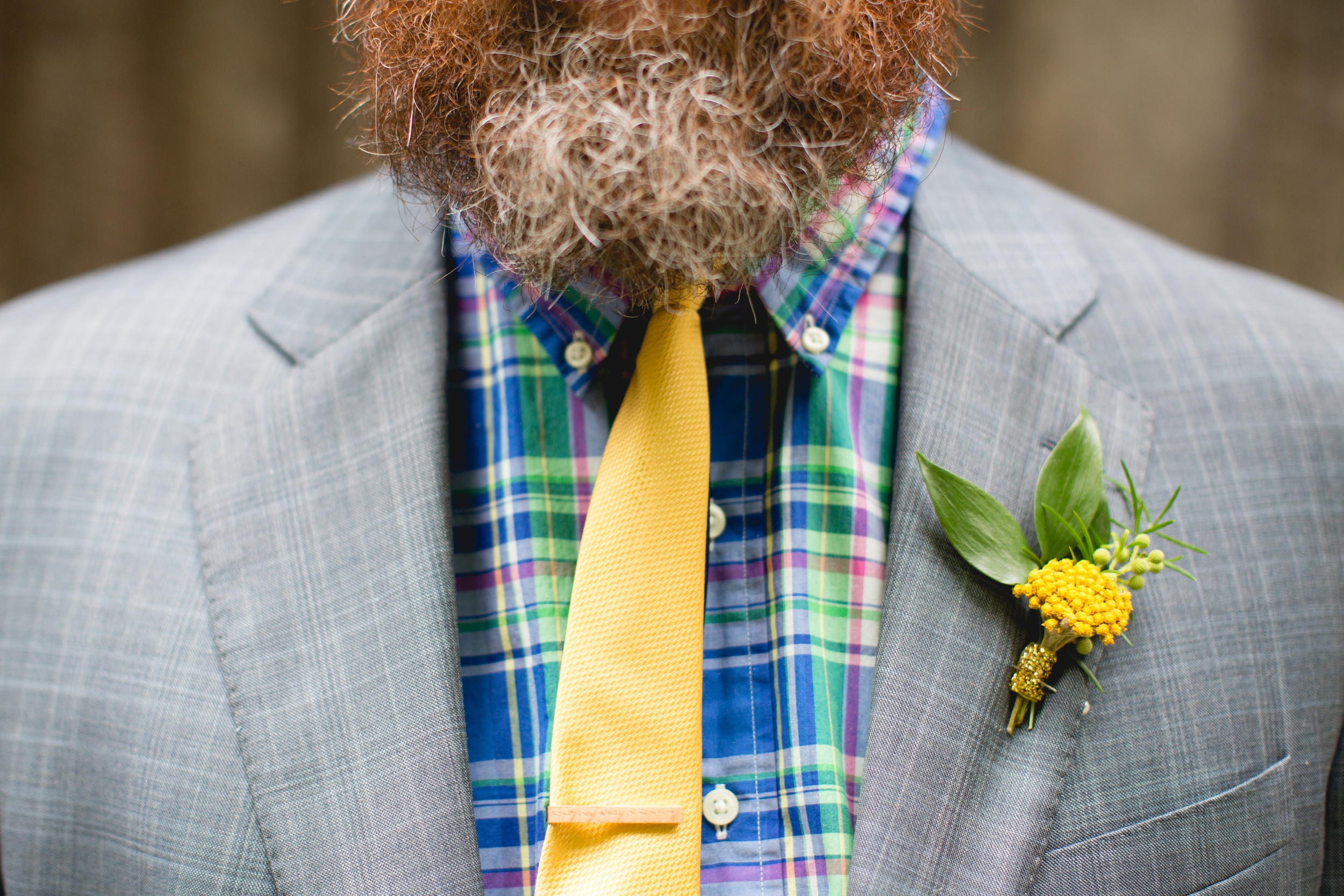 Bright yellow boutonniere