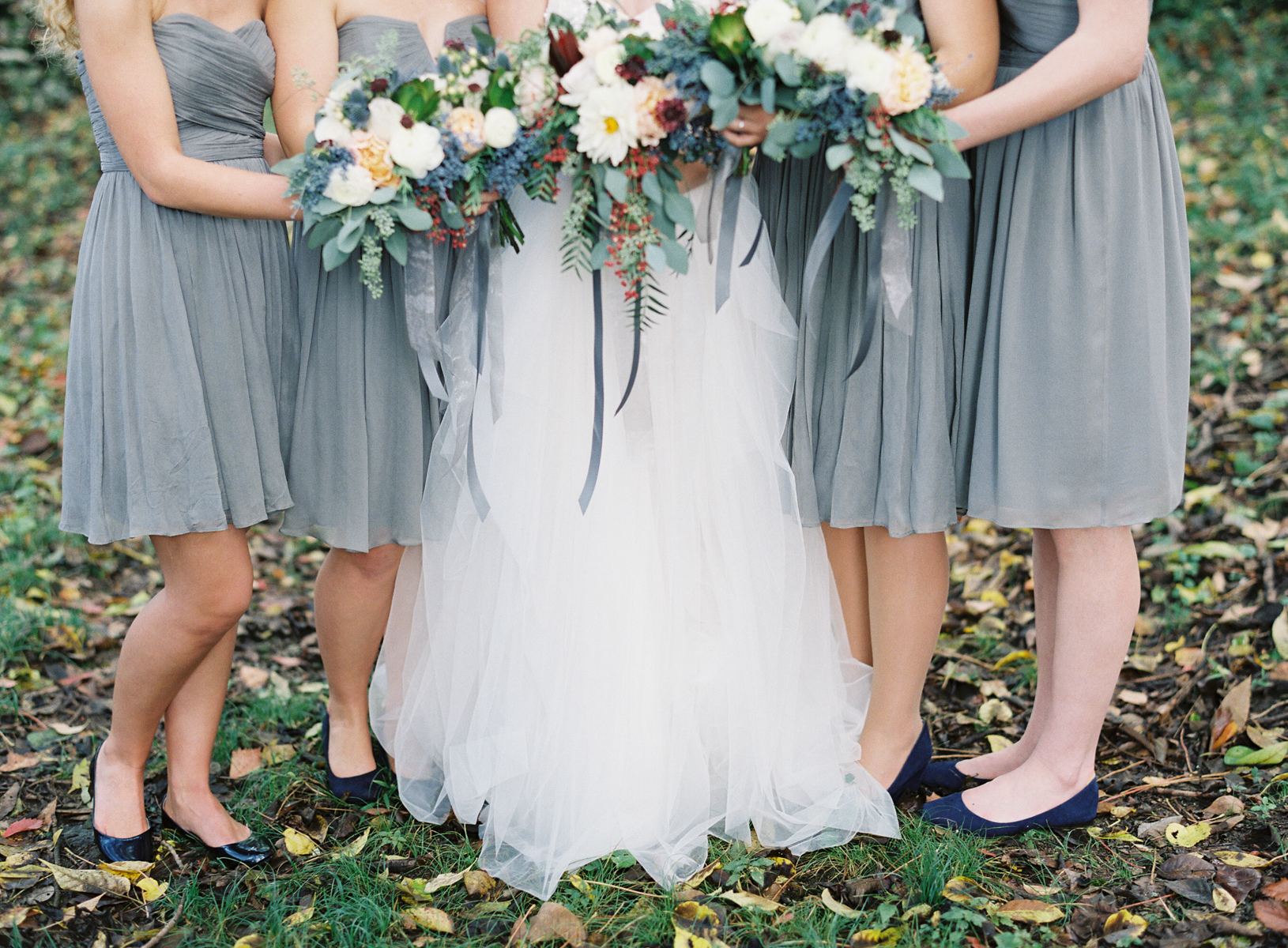 Grey bridesmaids dresses, bouquets with pops of peach, burgundy, and navy // Nashville Wedding Florist
