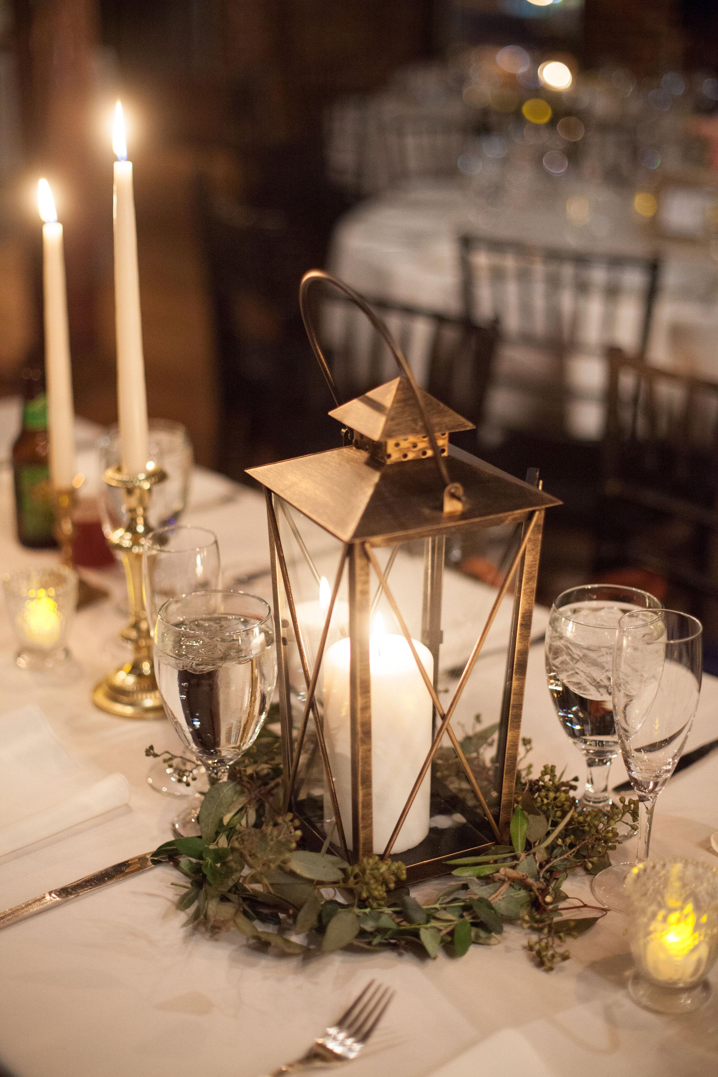 Lantern centerpieces with greenery // Nashville Wedding Floral Design