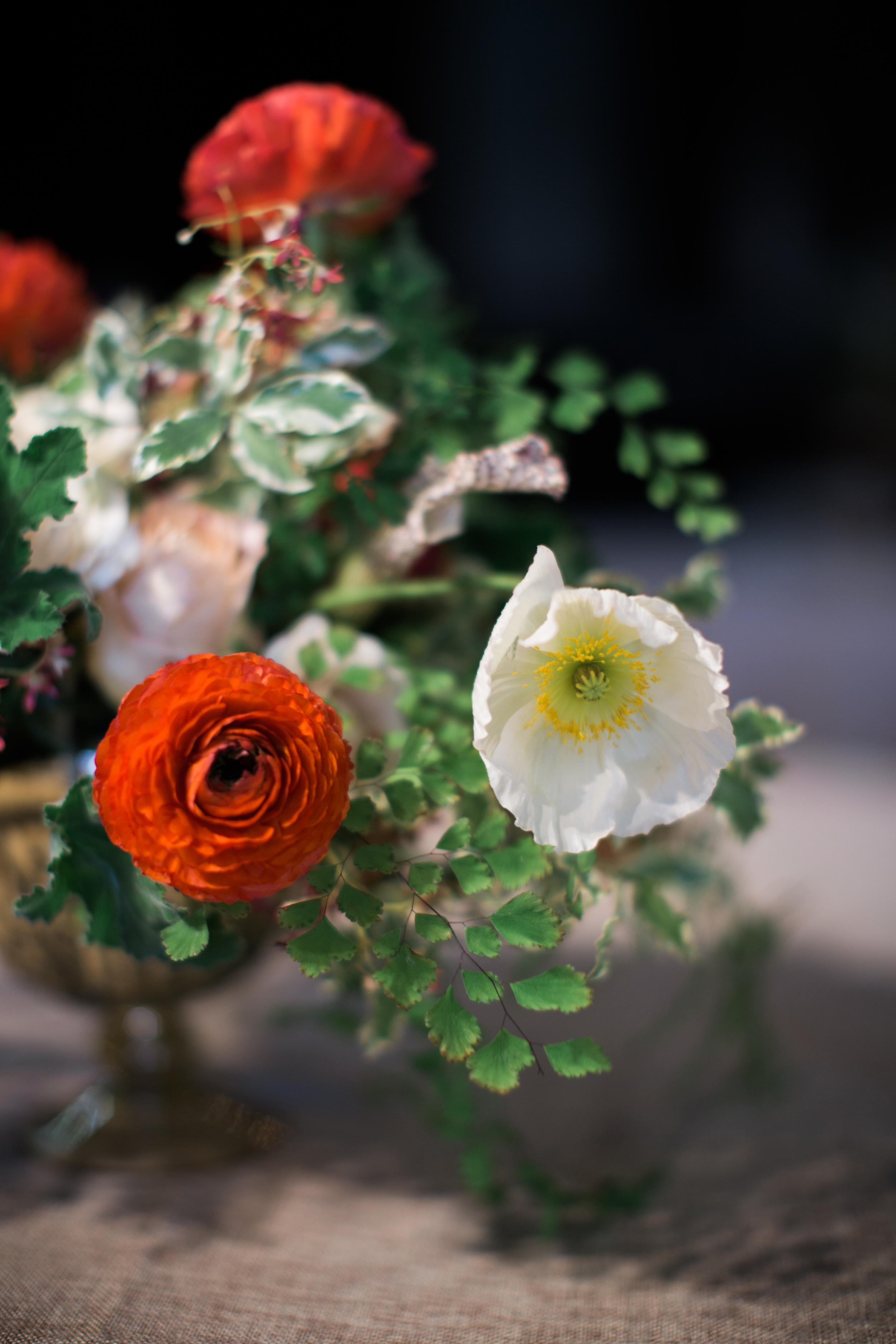 Centerpiece with poppies and ranunculus // Nashville Wedding Floral Design