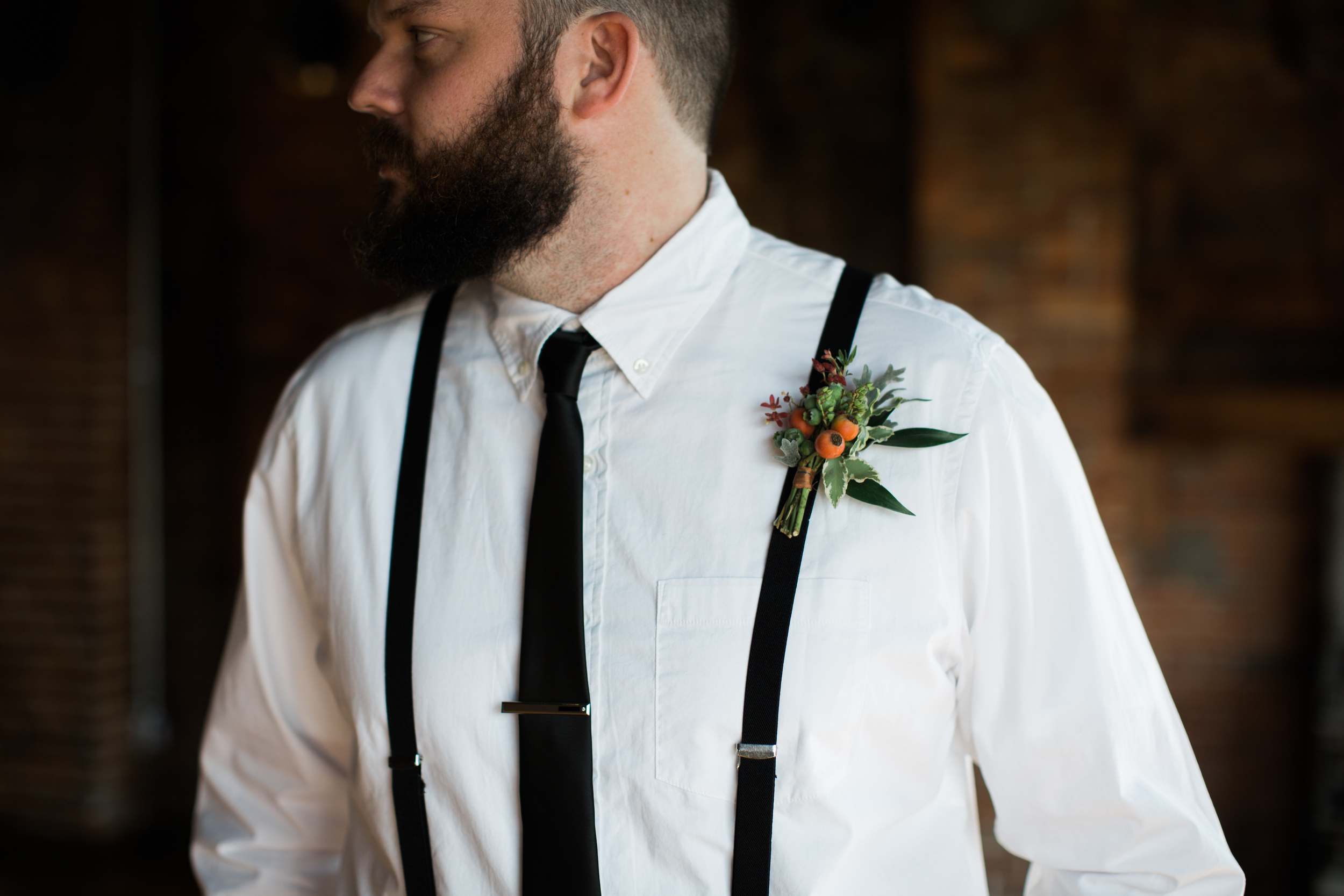 Boutonniere with berries and rosehips // Nashville Wedding Flowers