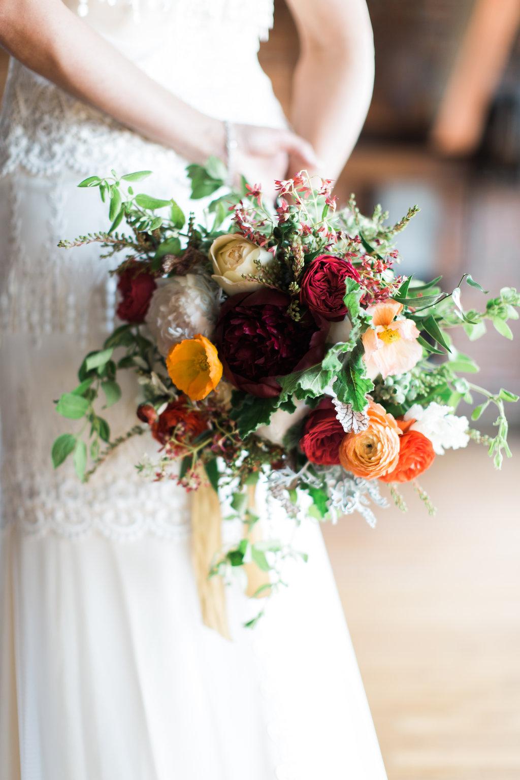 Red peonies, garden roses, ranunculus, and honeysuckle / Nashville Wedding Florist