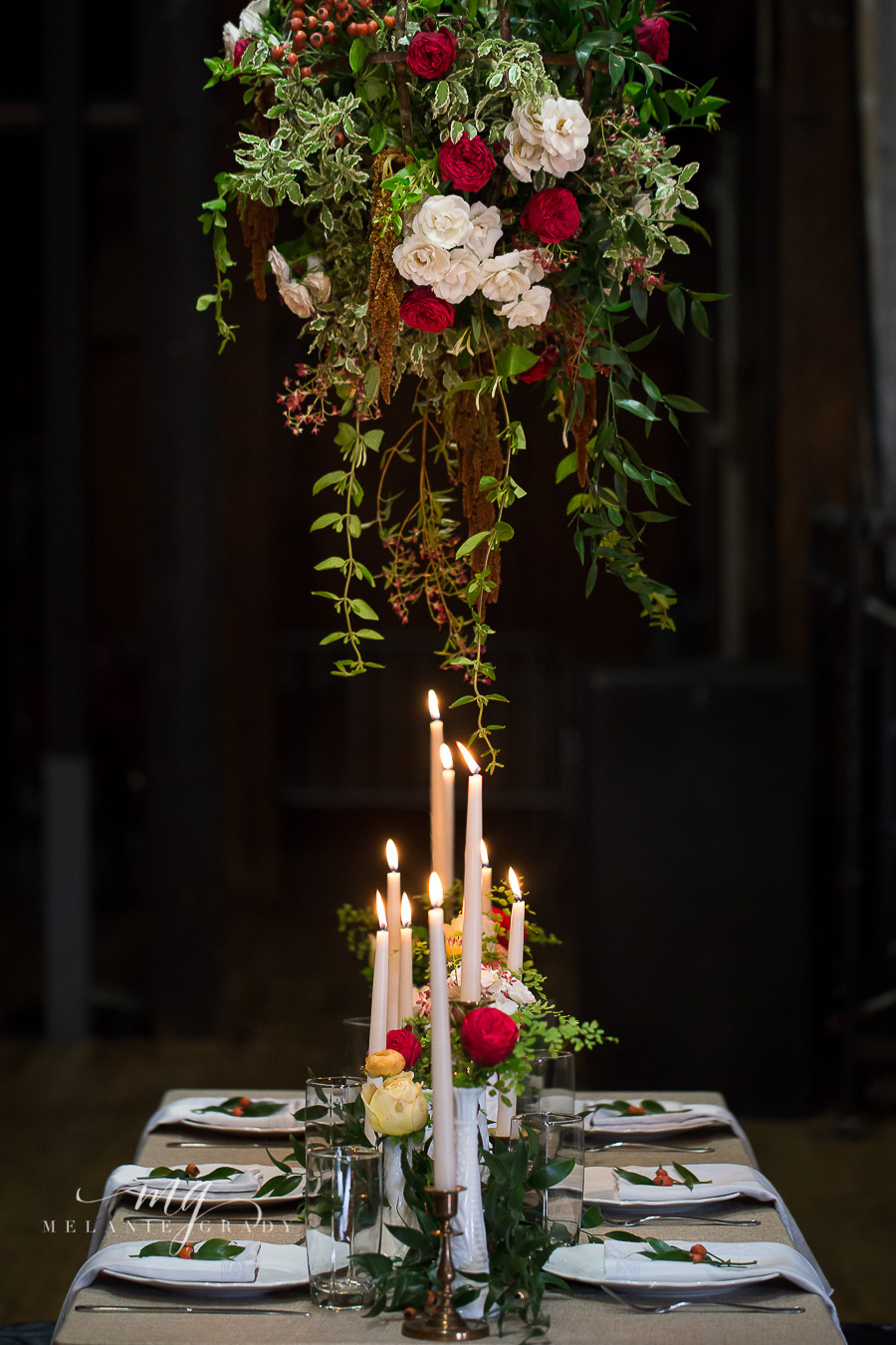 Head table with hanging arrangement, candles, and garland // Nashville Wedding Florist
