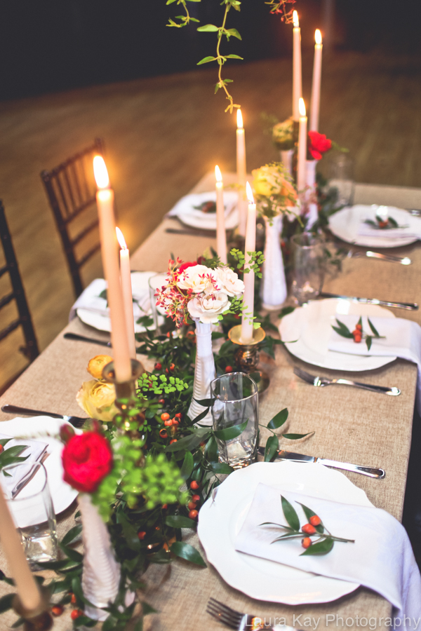 Head Table with garland, tapers, and bud vases // Nashville Wedding Floral Design at Cannery One