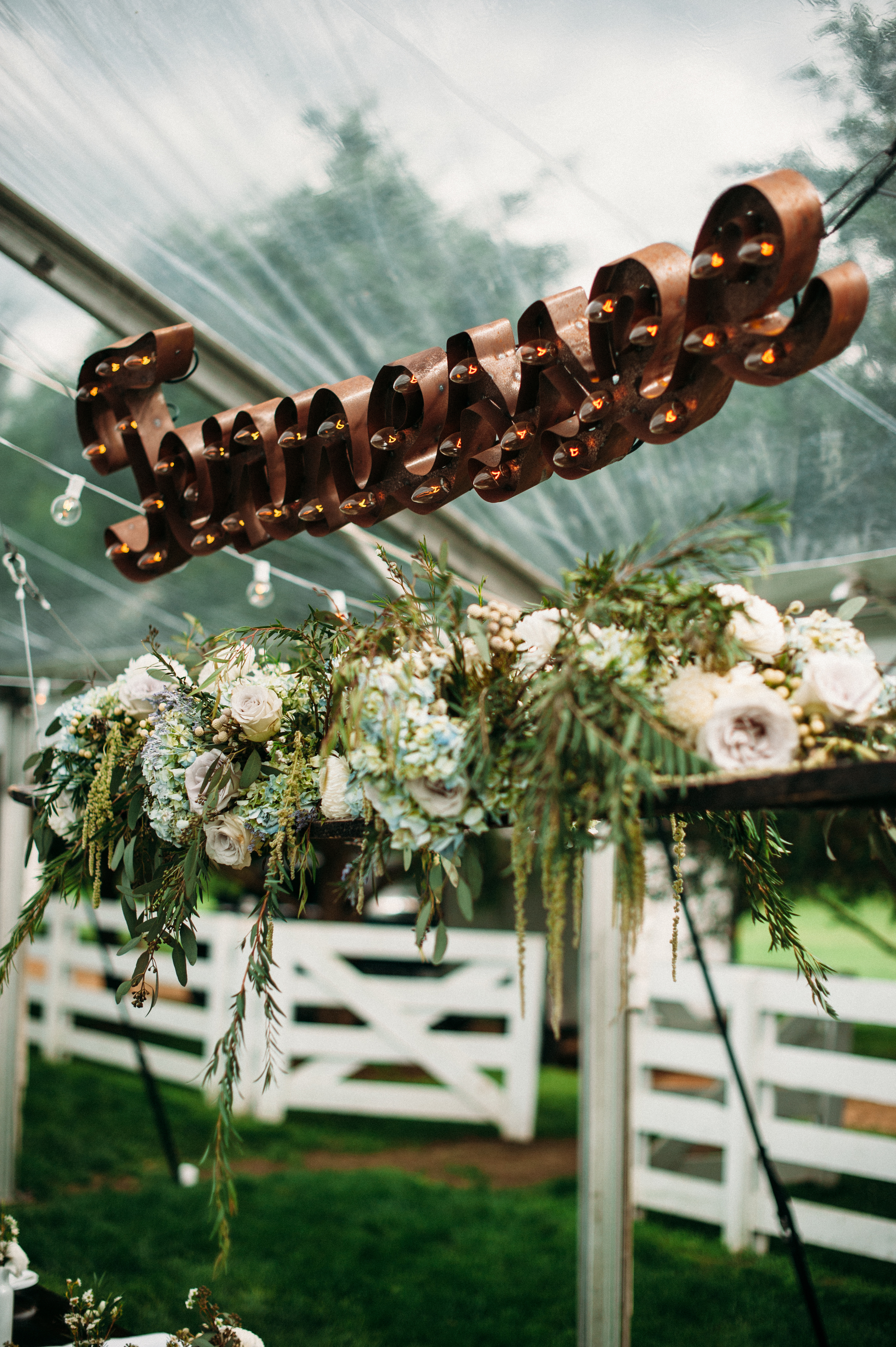 Hanging flower installation with marquee sign // Nashville Wedding Florist