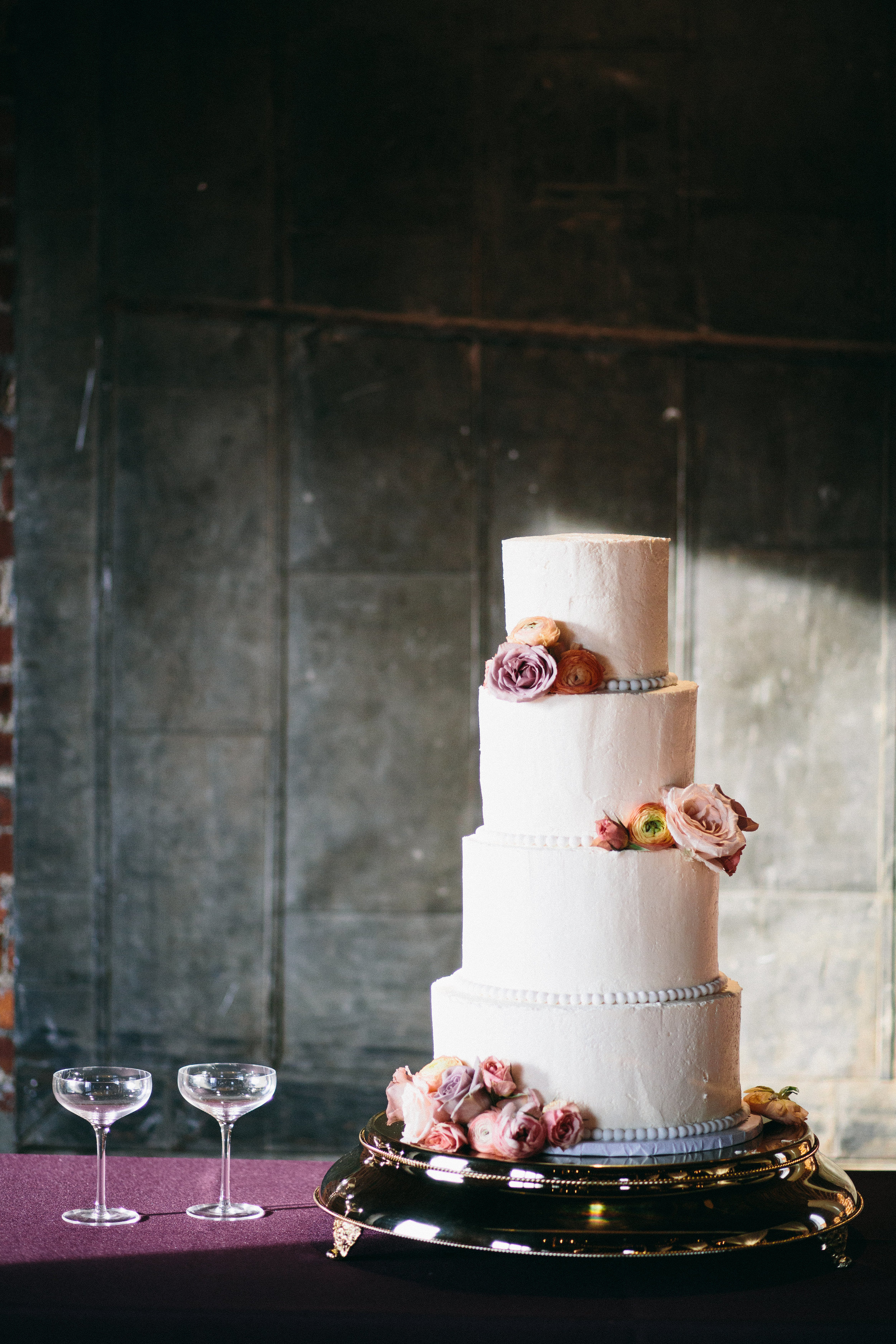 Wedding cake with floral accents // Mauve and coral wedding flowers // Nashville Floral Design