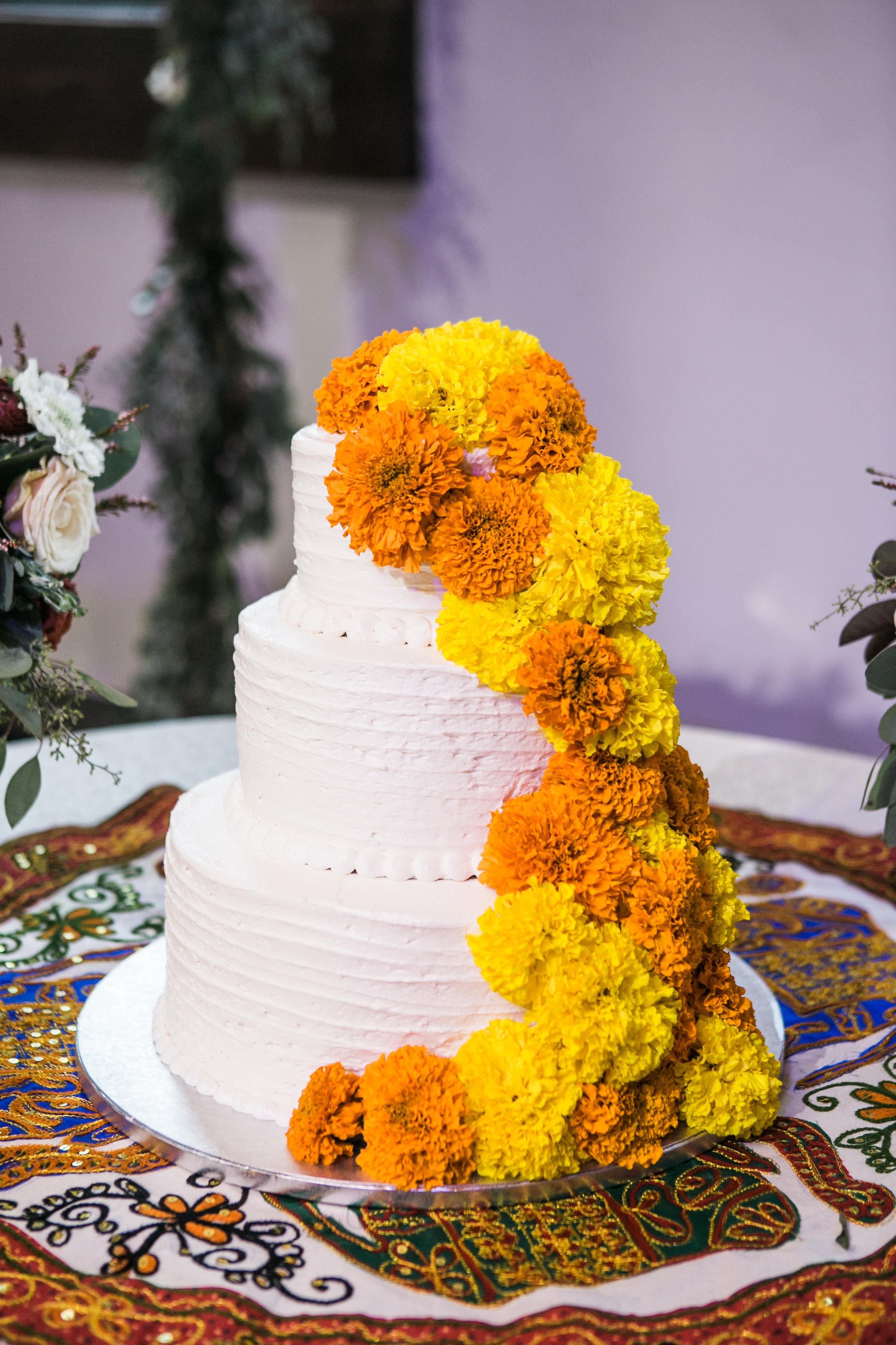Cake with yellow marigolds // Nashville Wedding Florist