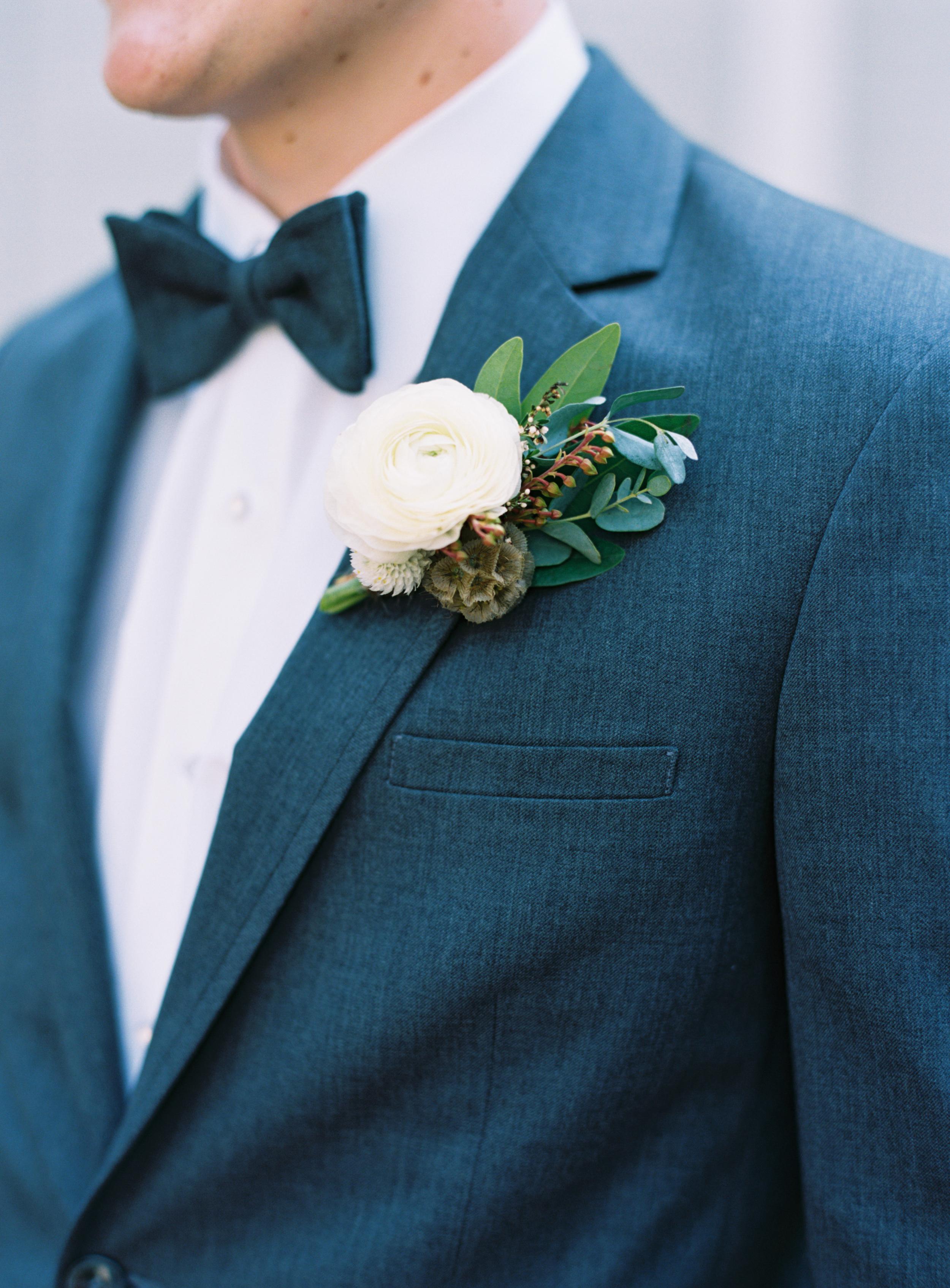 Natural, rustic boutonniere with ranunculus // Nashville Wedding Floral Design
