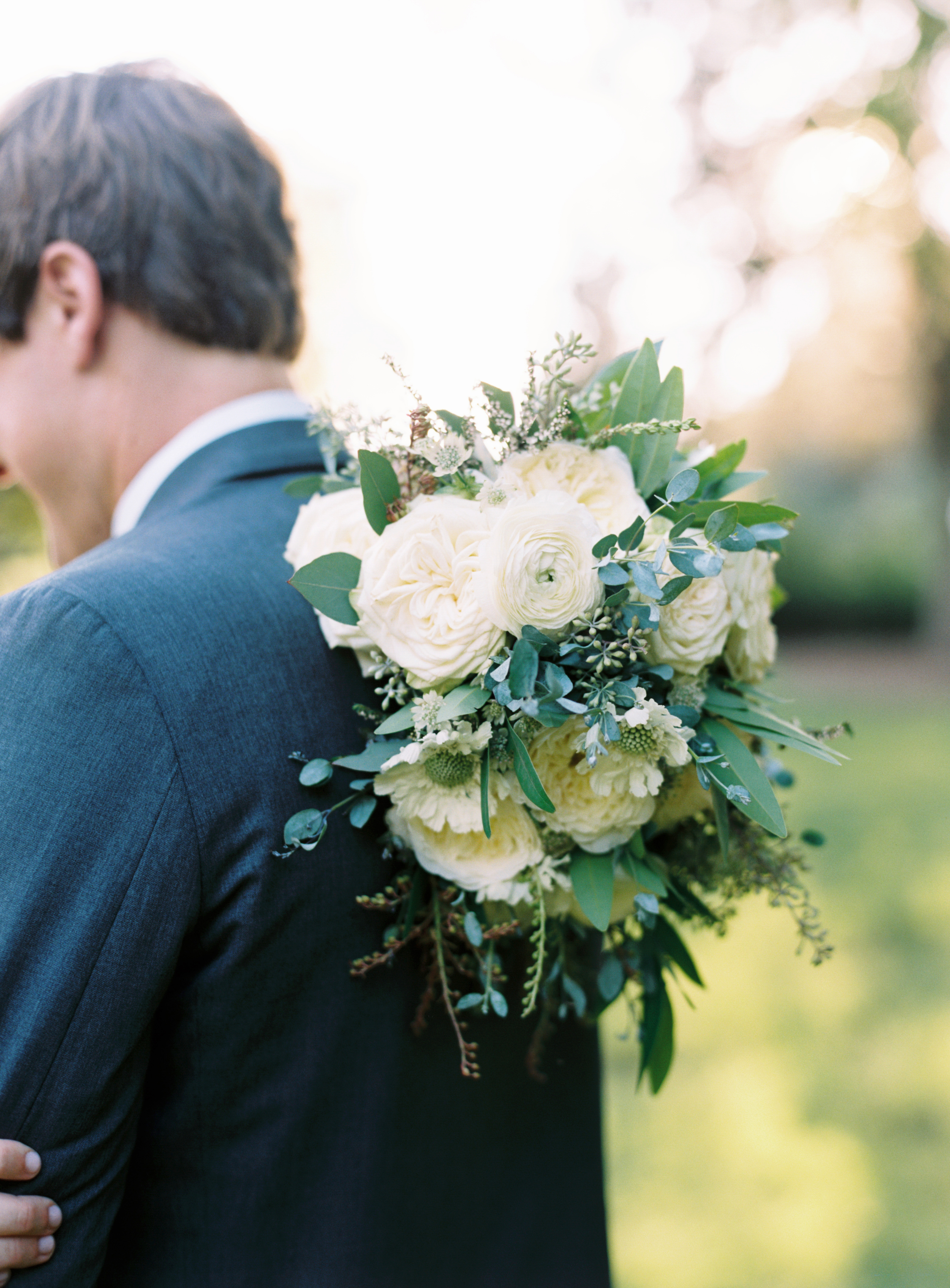 Natural light // All white and greenery bride's bouquet