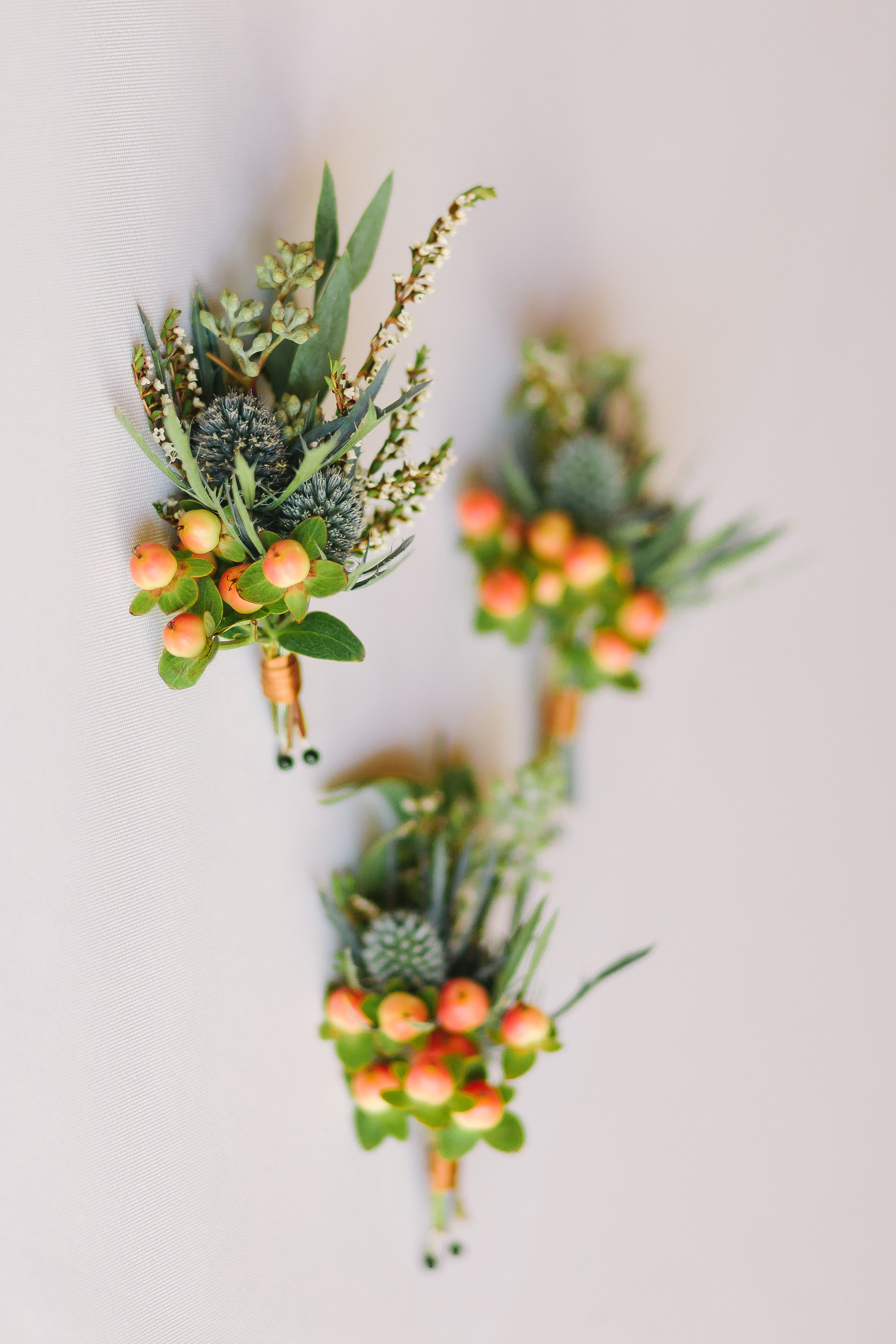 Rustic boutonniere with thistles and berries // Nashville Wedding Florist